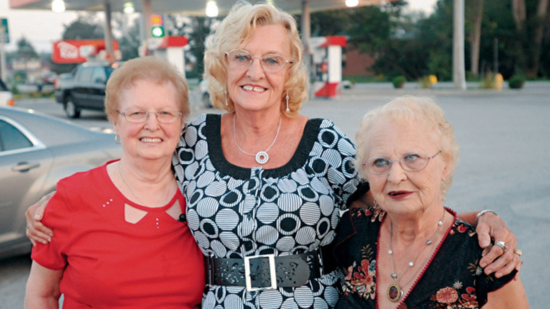 In this Sept. 10, 2013 photo, three sisters, from left, Shirley Mortellaro, 78, Mary Kidwell, 77, and Joan Billings, 80 are reunited in Batavia, N.Y., 73 years after their mother abandoned the older two in Toronto and disappeared with Mary.