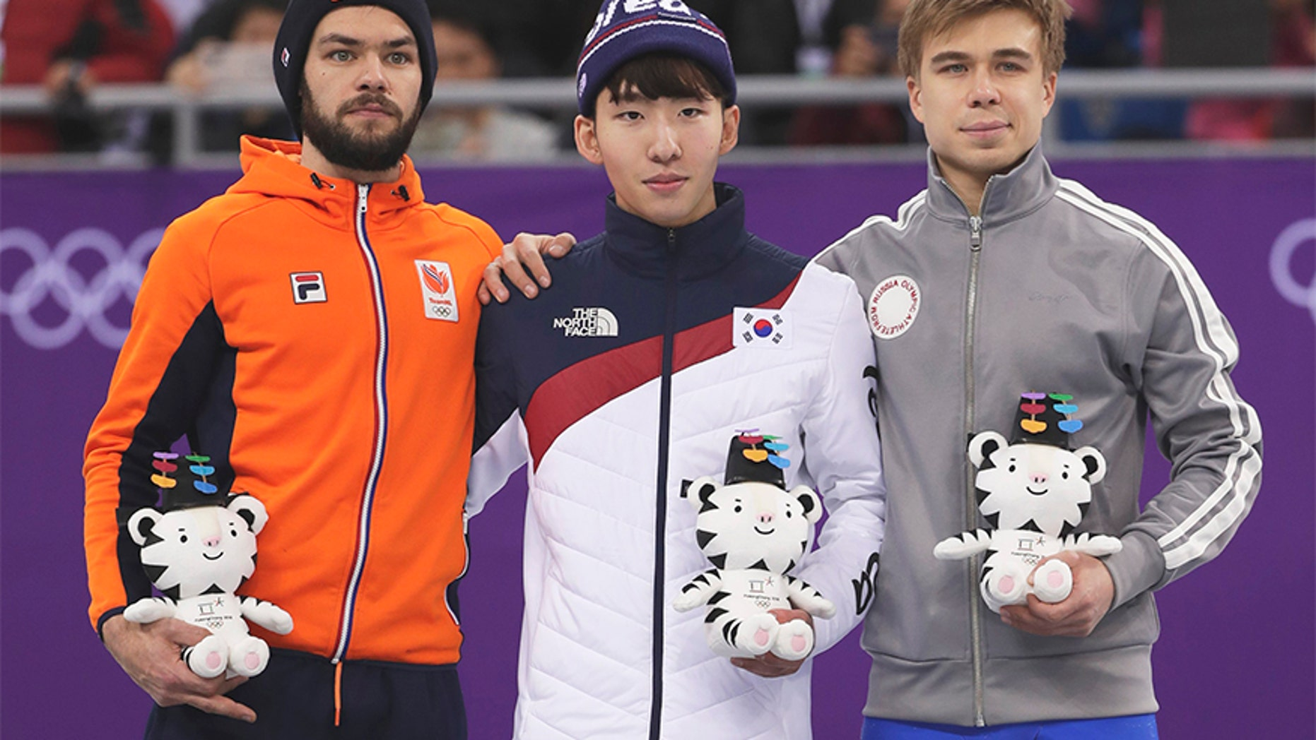 Feb. 10, 2018: Lim Hyojun, center, of South Korea stands on a podium during a Venue Ceremony following his win in the men's 1500 meters short-track speedskating final in the Gangneung Ice Arena at the 2018 Winter Olympics.