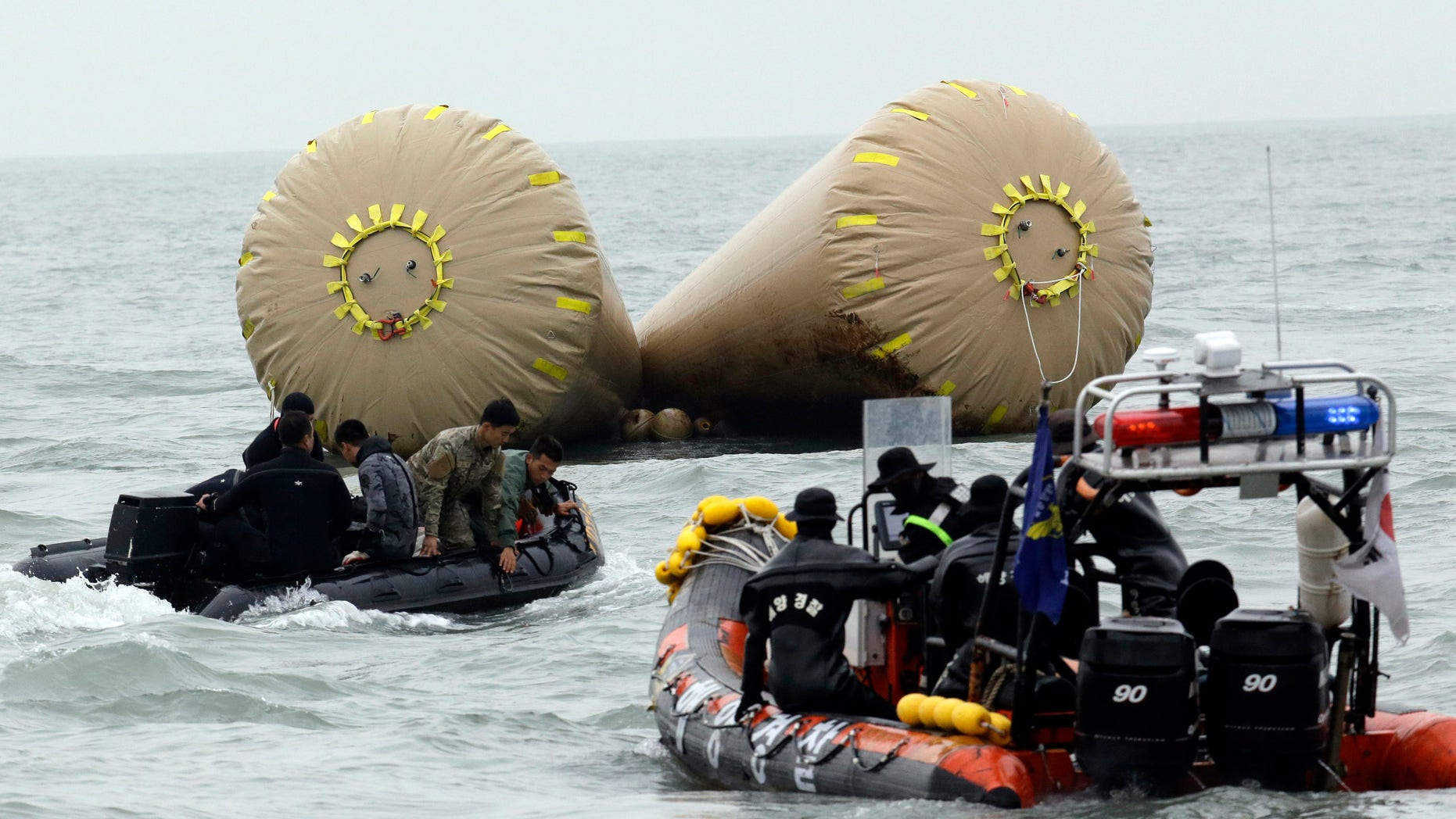 April 19, 2014: South Korean rescue members search passengers believed to have been trapped in the sunken ferry Sewol near the buoys which were installed to mark the area in the water off the southern coast near Jindo, south of Seoul, South Korea.