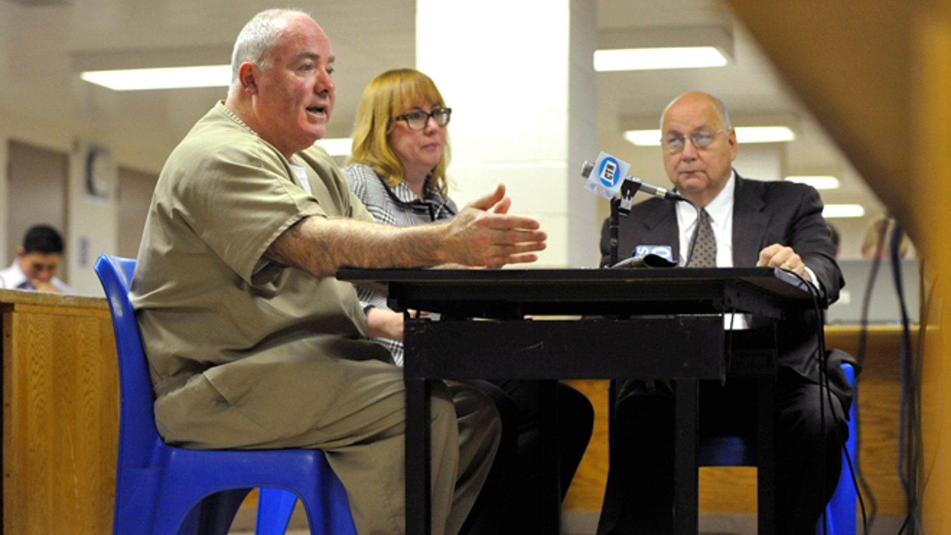 Oct. 24, 2012: Michael Skakel, left, addresses a parole board with his attorneys Hope Seeley, center, and Hubert Santos, right, at his side during a parole hearing at McDougall-Walker Correctional Institution in Suffield, Conn.