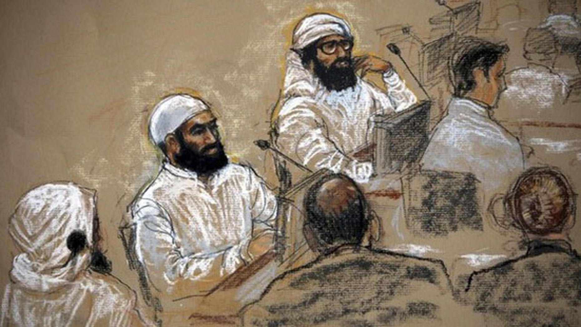 In this July 16, 2009 file photo of a sketch by courtroom artist Janet Hamlin, alleged September 11 co-conspirators sit with their legal teams inside the courtroom at Guantanamo Bay. Mustafa al Hawsawi is on the right.