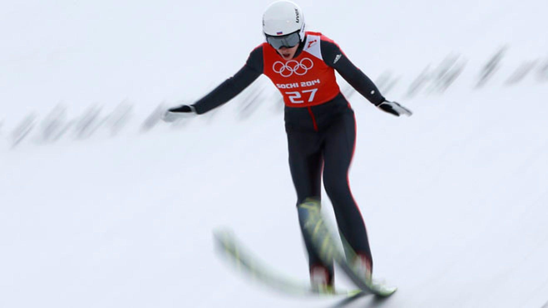 Feb. 9, 2014: Russia's Irina Avvakumova lands during a women's normal hill individual training session at the 2014 Winter Olympics in Krasnaya Polyana, Russia.