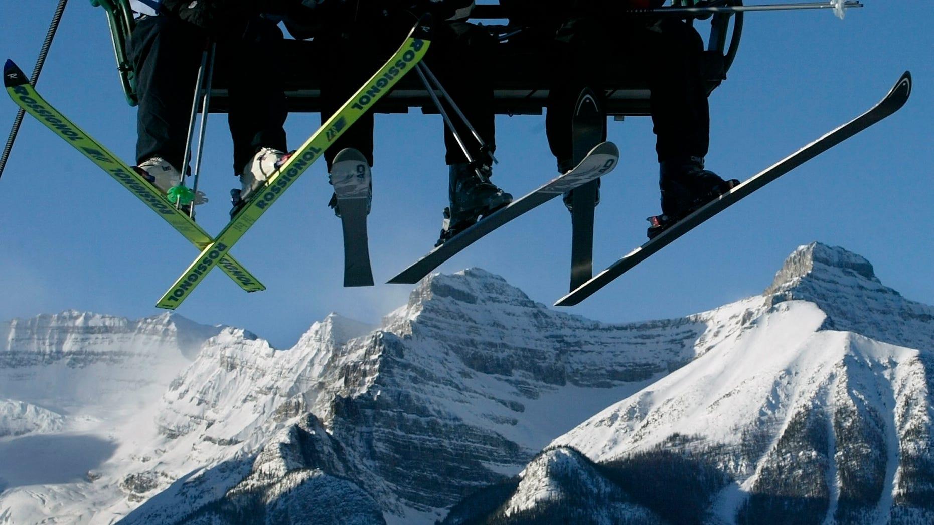 Skiers ride the lift in Lake Louise, Alberta November 30, 2003. (REUTERS/AndyClarkAC/HB)