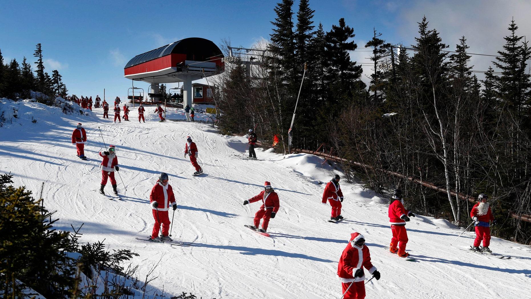 Skiers dressed as Santa Claus ski en masse in Maine.
