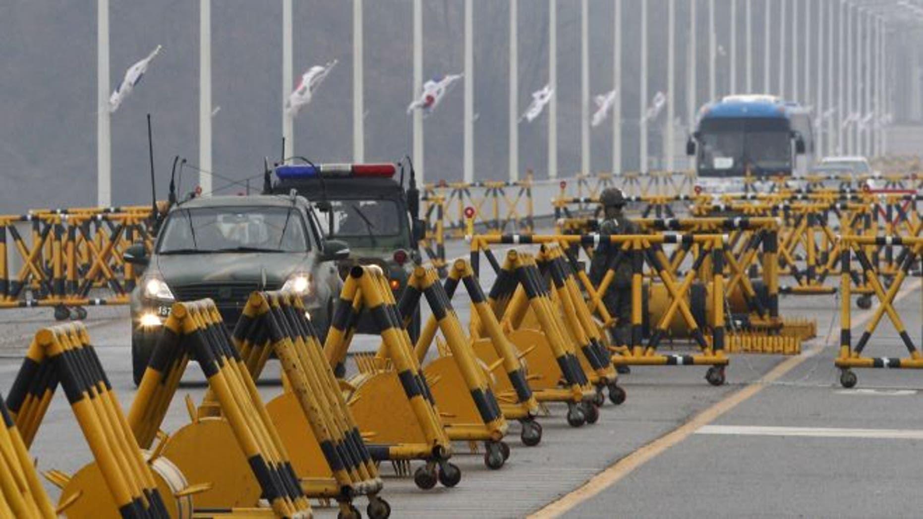 April 6, 2013: South Korean army vehicles cross Unification Bridge in Paju, South Korea, near the border village of Panmunjom.