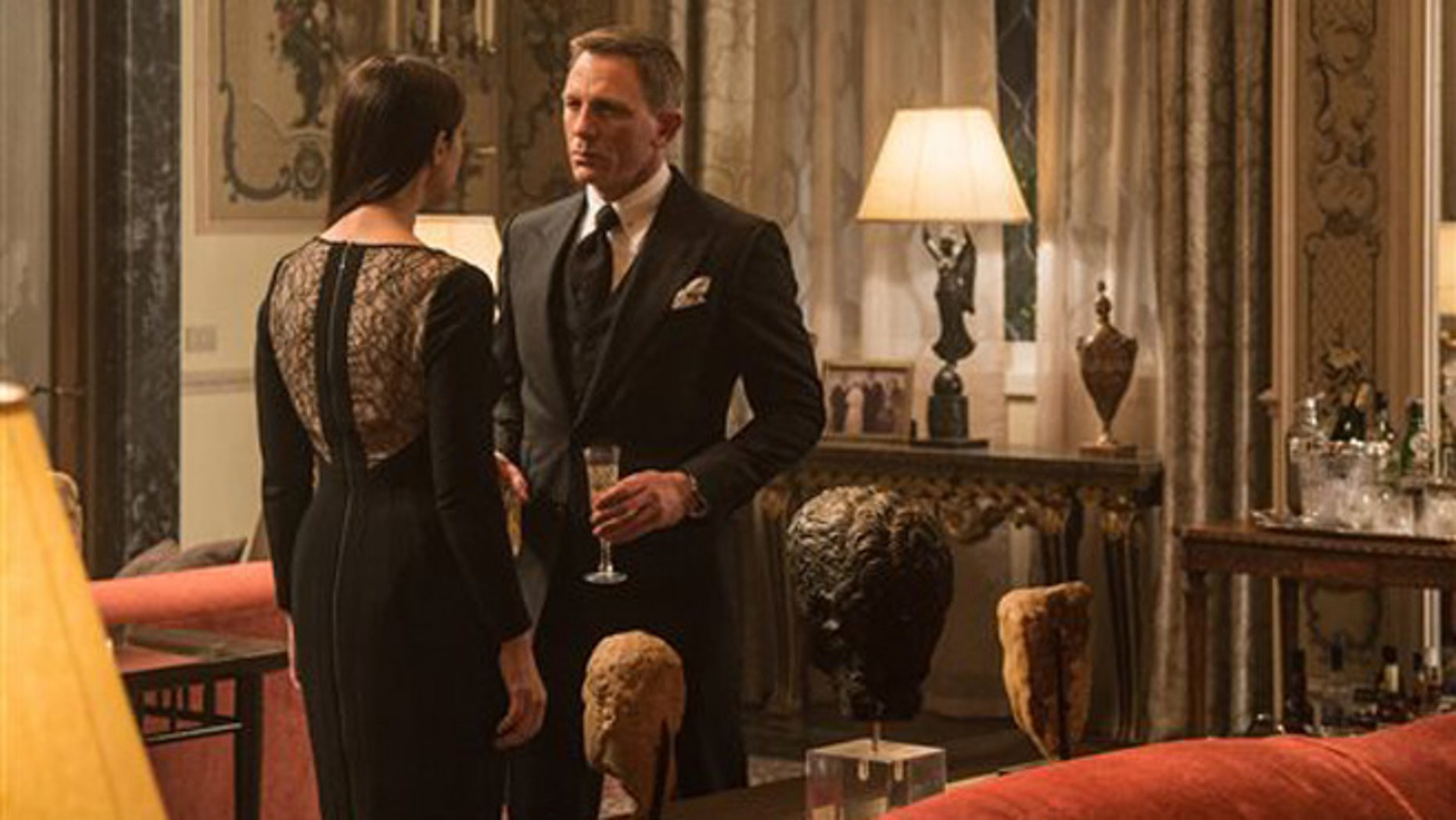 """In this image released by Metro-Goldwyn-Mayer Pictures/Columbia Pictures/EON Productions, Monica Bellucci, left, and Daniel Craig appear in a scene from the James Bond film, """"Spectre."""""""