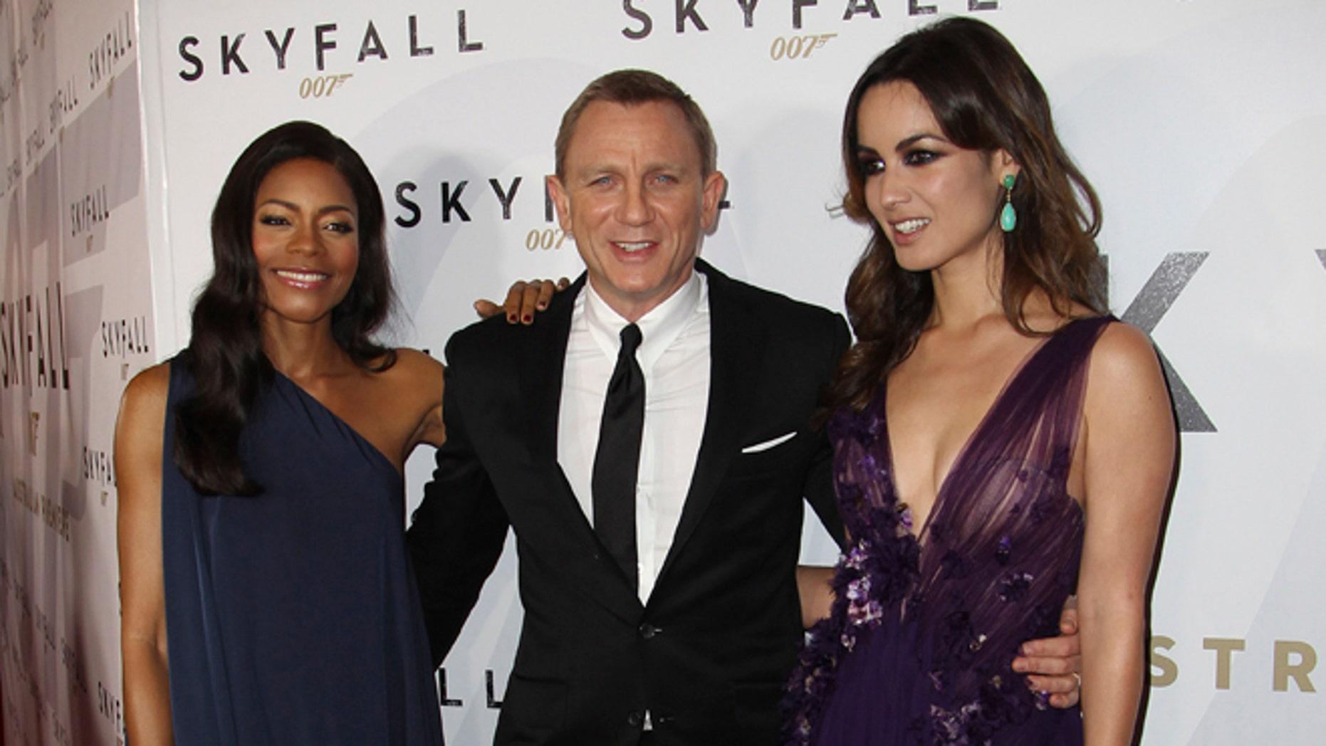 "Nov. 16, 2012: Actors Daniel Craig centre, Naomie Harris left, and Berenice Marlohe pose for photos during the premier of the latest James Bond film, ""Skyfall"" in Sydney, Australia."