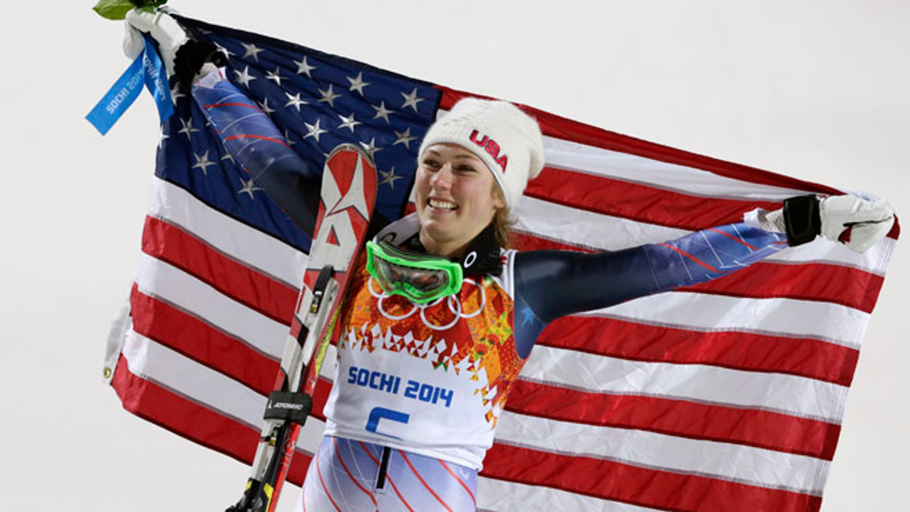 Feb. 21, 2014: Women's slalom gold medal winner Mikaela Shiffrin of the United States poses for photographers with the U.S. flag at the Sochi 2014 Winter Olympics.