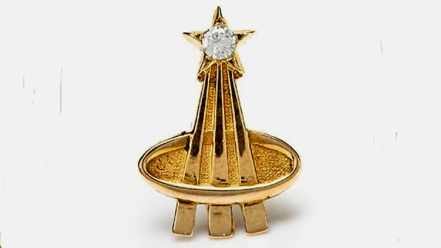 A diamond and gold pin given to Deke Slayton by the widows of the astronauts killed in the Apollo 1 fire.