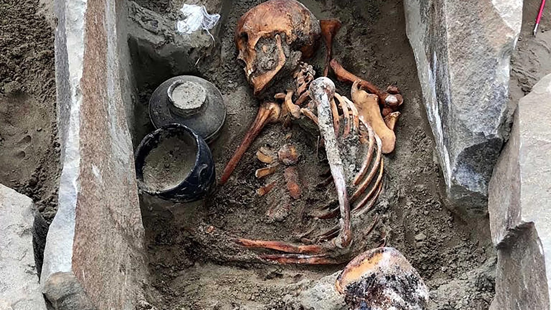 The 2,000-year-old mummy, dubbed Sleeping Beauty, was buried in silk clothes and a beaded belt with a jet buckle. Credit: Marina Kilunovskaya/The Siberian Times