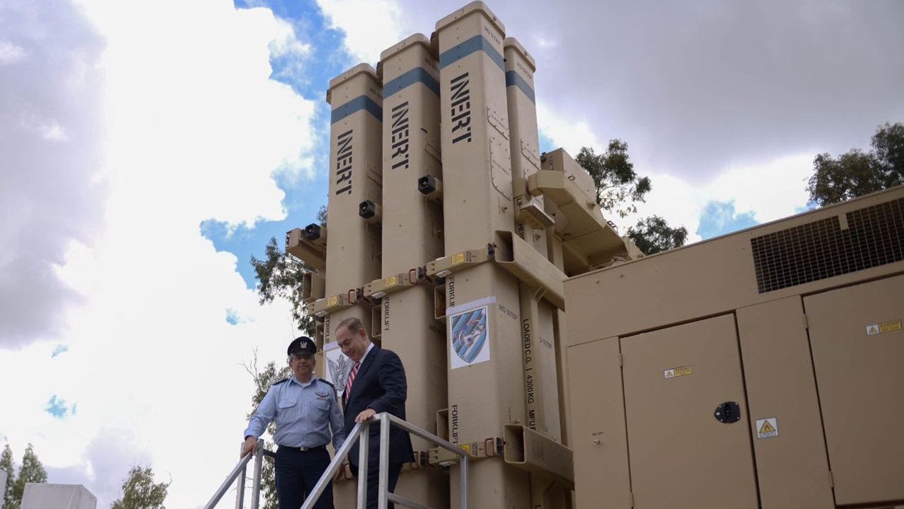 Israeli Prime Minister Benjamin Netanyahu (above, right) gets close to the David's Sling Air Defense System at the inauguration ceremony of the joint U.S.-Israeli missile interceptor at the Hatzor Air Base, Israel, on April 2, 2017. (CREDIT: Israel Defense Forces)