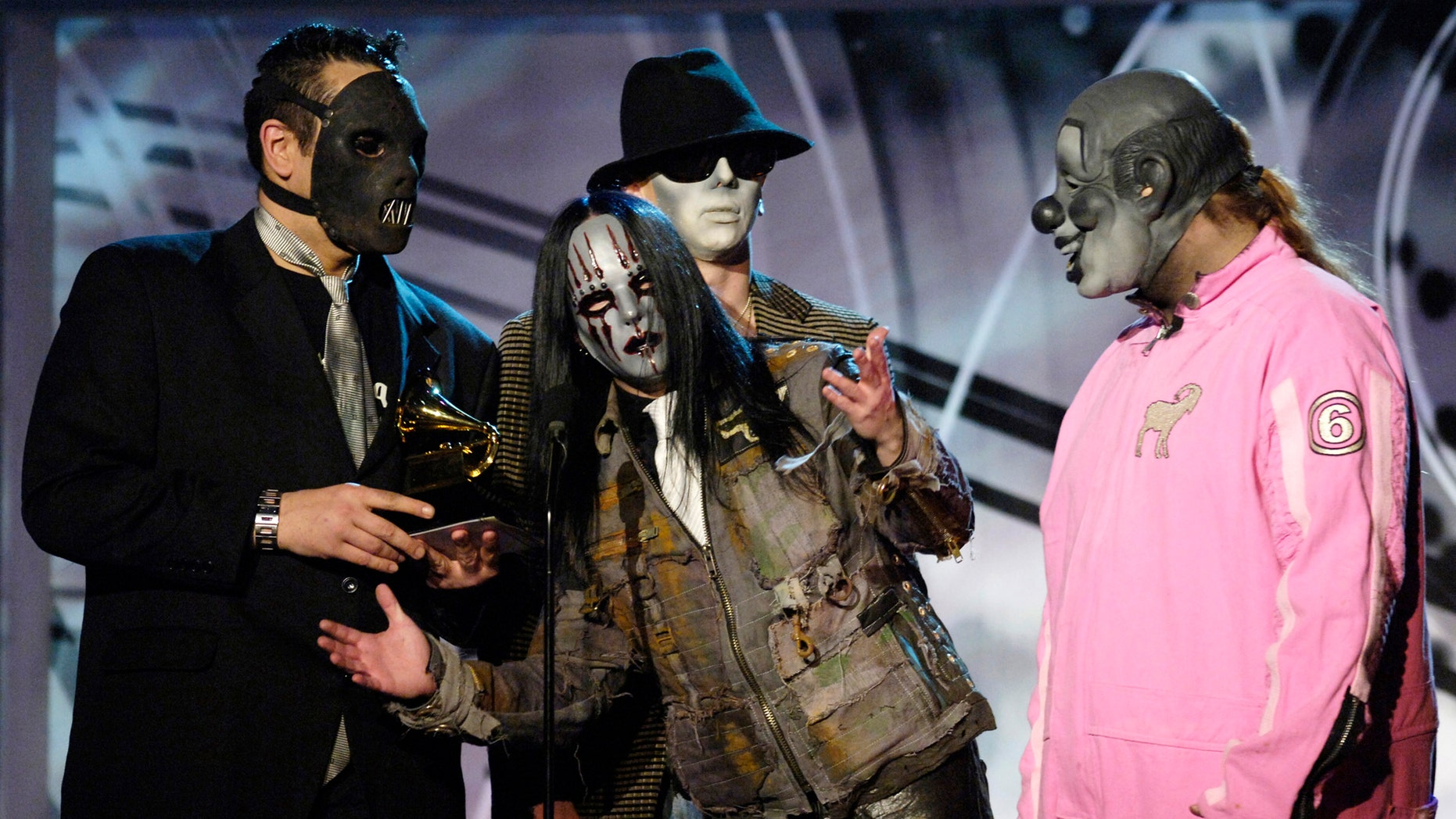 "Members of music group Slipknot pose with their award for best metal performance for ""Before I Forget"" at the 48th annual Grammy Awards in Los Angeles February 8, 2006.REUTERS/Chris Pizzello - RTR16026"