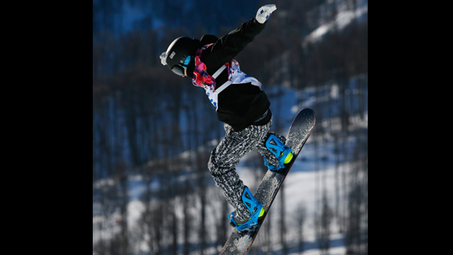 Feb. 6, 2014: Finland's Peetu Piiroinen takes a jump during men's snowboard slopestyle qualifying at the Rosa Khutor Extreme Park ahead of the 2014 Winter Olympics in Krasnaya Polyana, Russia.