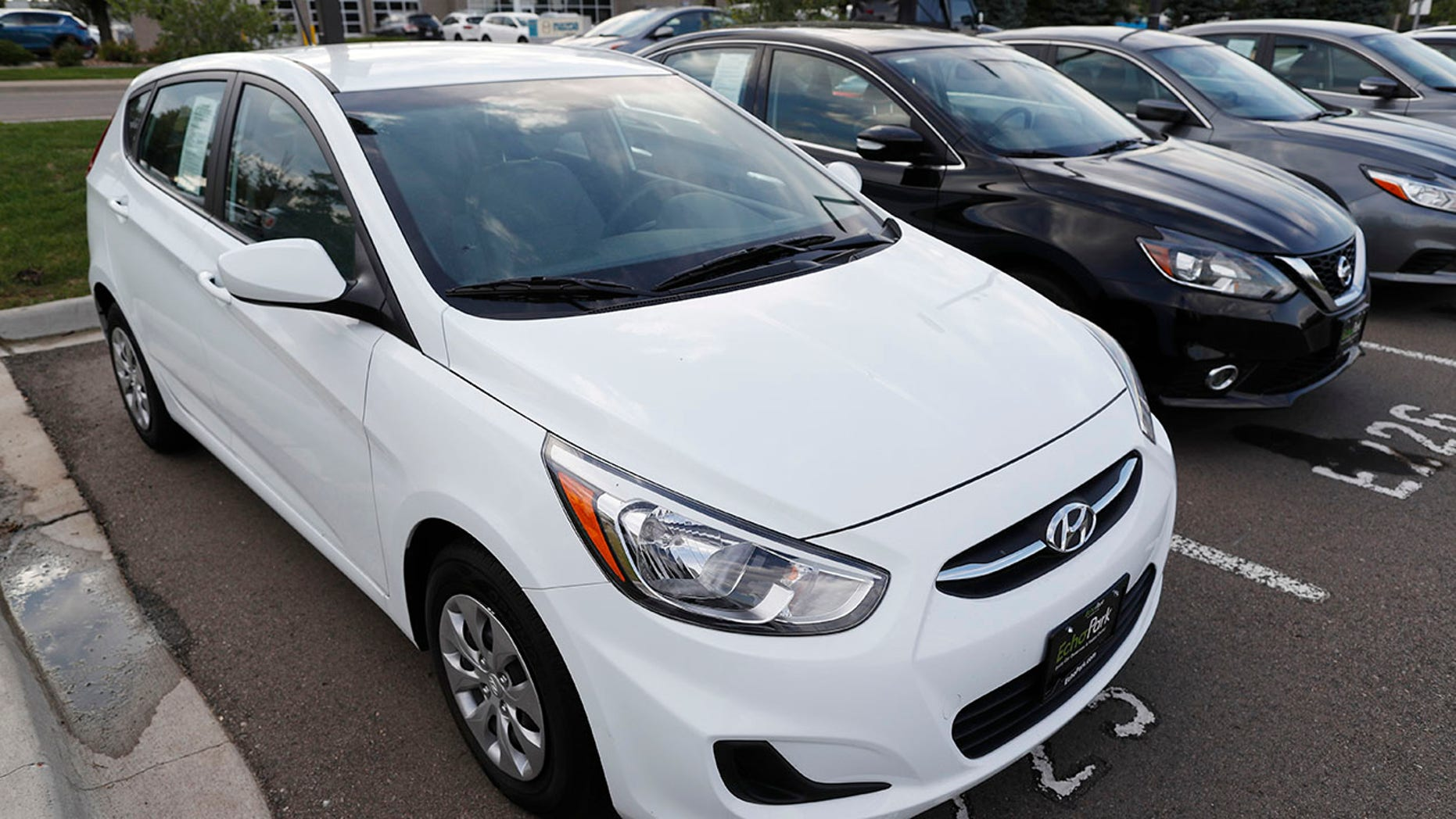 In this Tuesday, June 26, 2018, photograph, a used 2017 Hyundai Accent hatchback sits in a row of other used, late-model sedans at a dealership in Centennial, Colo. Prices of used small cars are on the rise after falling for the past five years. (AP Photo/David Zalubowski)
