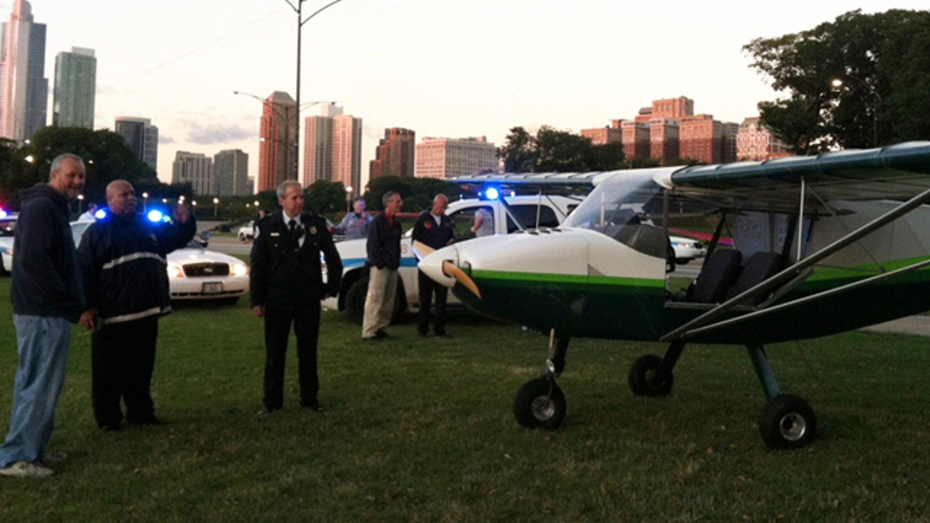 Sept. 22, 2013: Pilot John Pederson,left, 51, far left, landed his single-engine plane near Lake Shore Drive in Chicago.