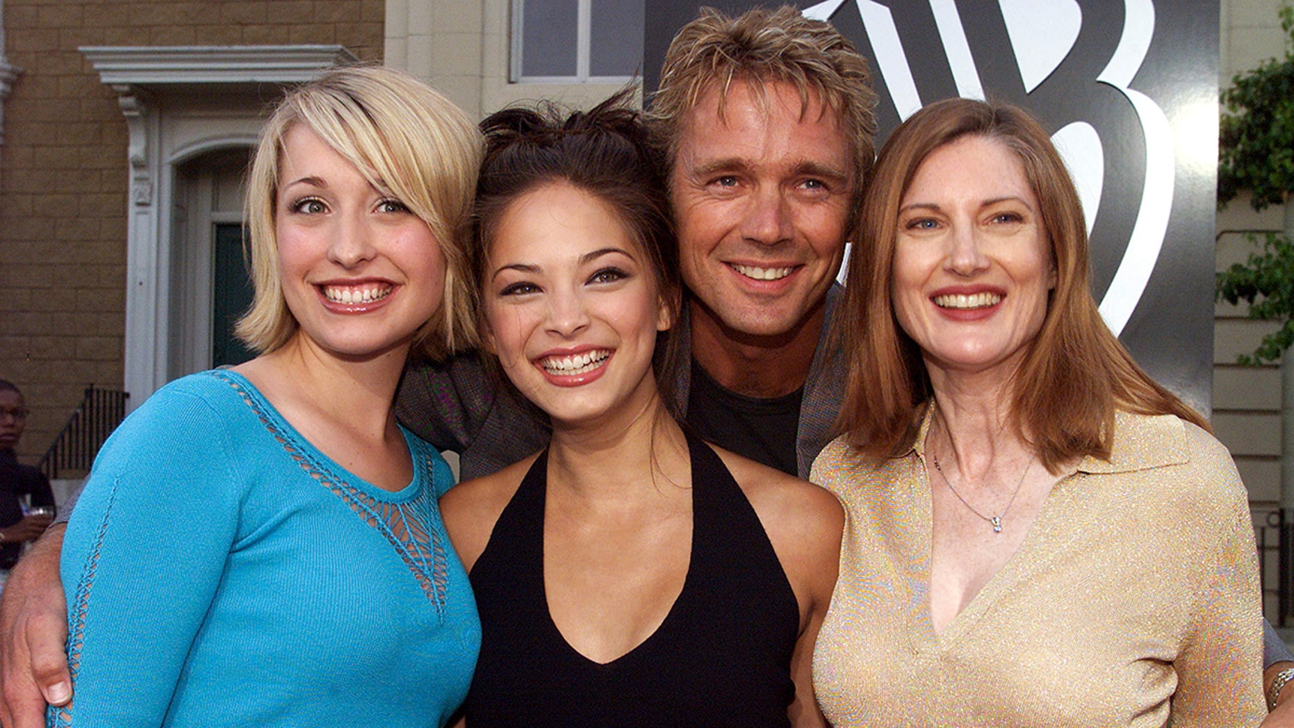 """Actor John Scheneider poses with co-stars (L-R) Allison Mack, Kristin Kreuk and Annette O'Toole from the new WB television network action series """"Smallvile""""  at the network's summer All-Star party at the Warner Bros. Studios in Burbank, California, July 15, 2001. The series depicts the classic Superman character as a teenaged Clark Kent. - PBEAHUKZNCQ"""