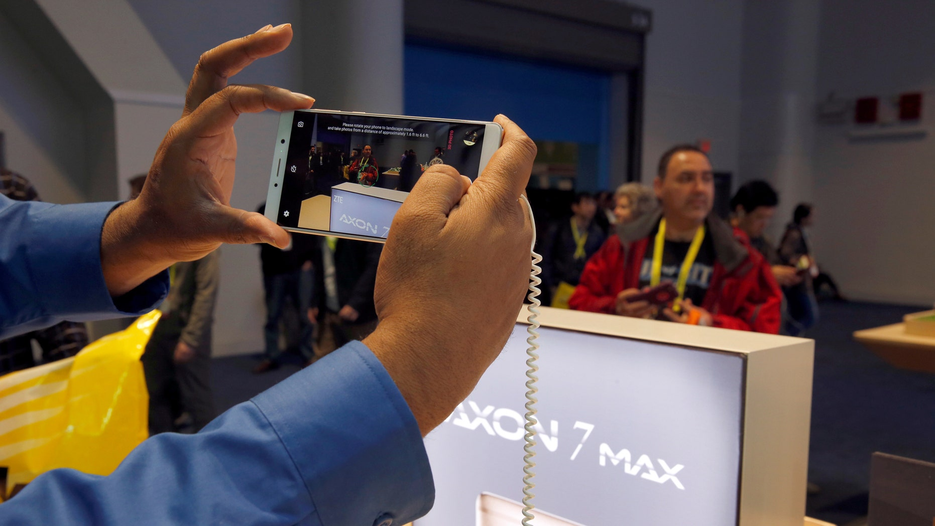 File photo: A man takes a photo with an Axon 7 Max smartphone with 3D camera at the ZTE booth during the 2017 CES in Las Vegas, Nevada January 6, 2017. (REUTERS/Steve Marcus)