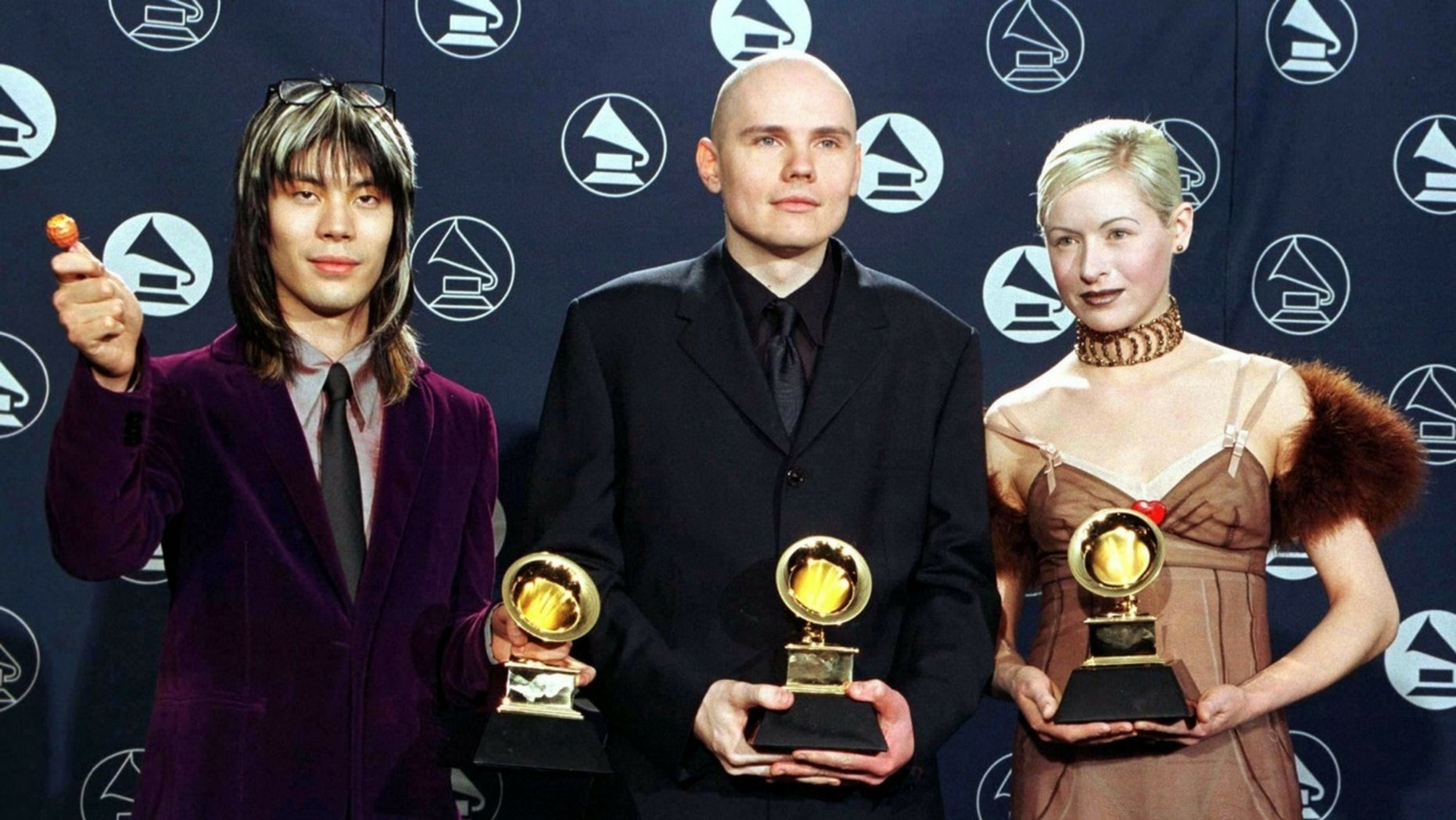 D'arcy Wretzky (right) claims she was not invited to The Smashing Pumpkins reunion.