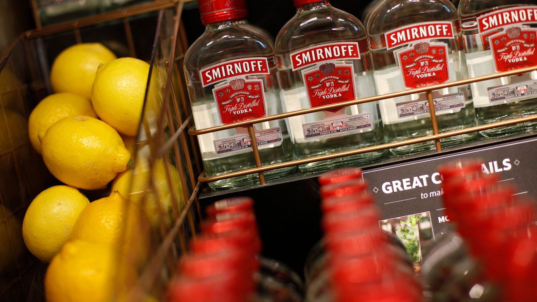 Smirnoff vodka and lemons are displayed in the liquor aisle at a Tesco Extra supermarket in Watford, north of London.
