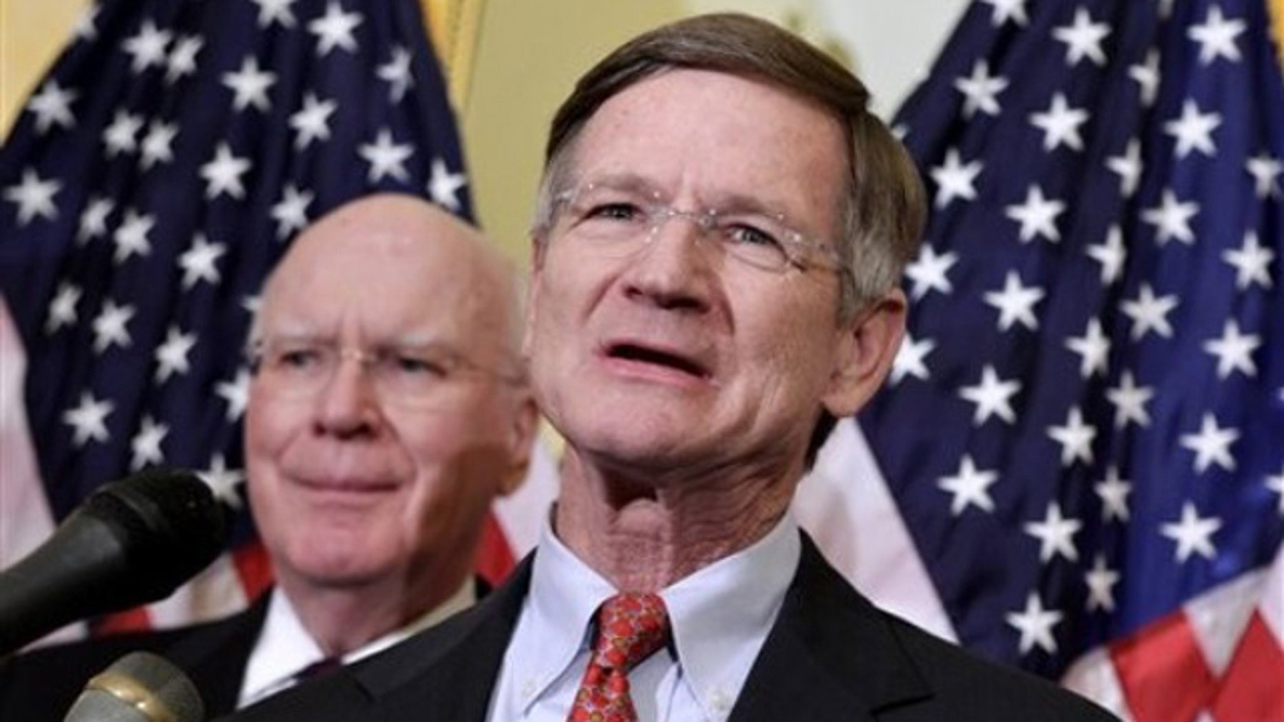 April 4, 2011: Rep. Lamar Smith, right, accompanied by Sen. Patrick Leahy, speaks during a news conference on Capitol Hill about online piracy.