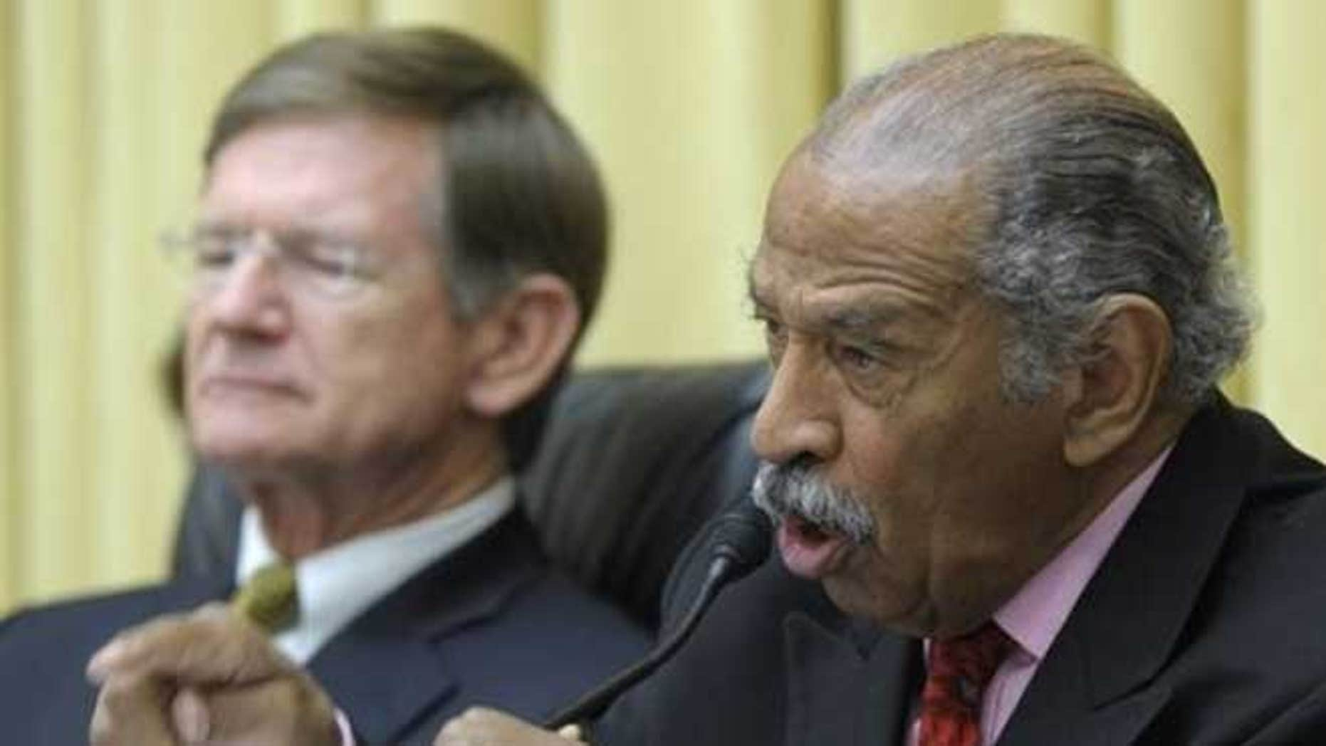 May 8, 2012: The House Judiciary Committee's ranking member Rep. John Conyers, D-Mich, right, accompanied by committee Chairman Rep. Lamar Smith, R-Texas, speaks on Capitol Hill in Washington.