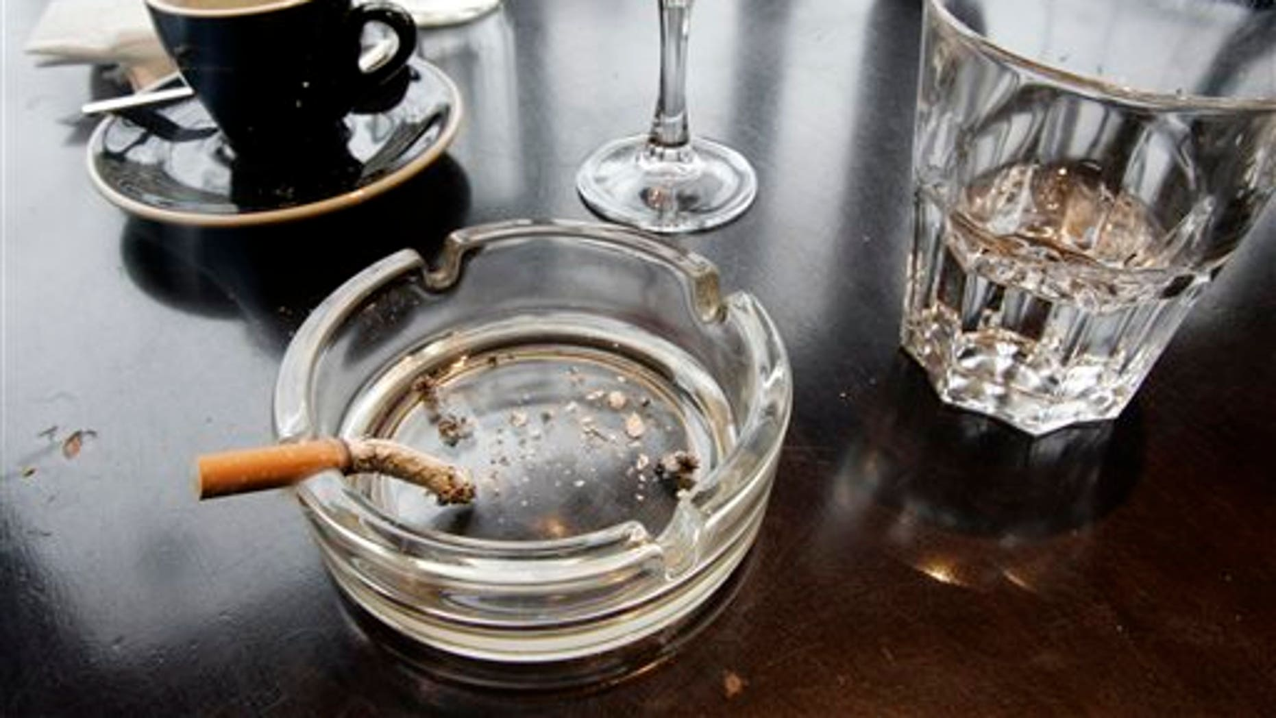 FILE - In this Thursday, Dec. 27, 2007 file photo, a cigarette burns out in an ashtray after lunch at a restaurant in Paris. According to a report released on Wednesday, Feb. 4, 2015, for the first time, lung cancer has passed breast cancer as the leading cause of cancer deaths for women in rich countries, according to the American Cancer Society based on new numbers from the International Agency for Research on Cancer. (AP Photo/Francois Mori)