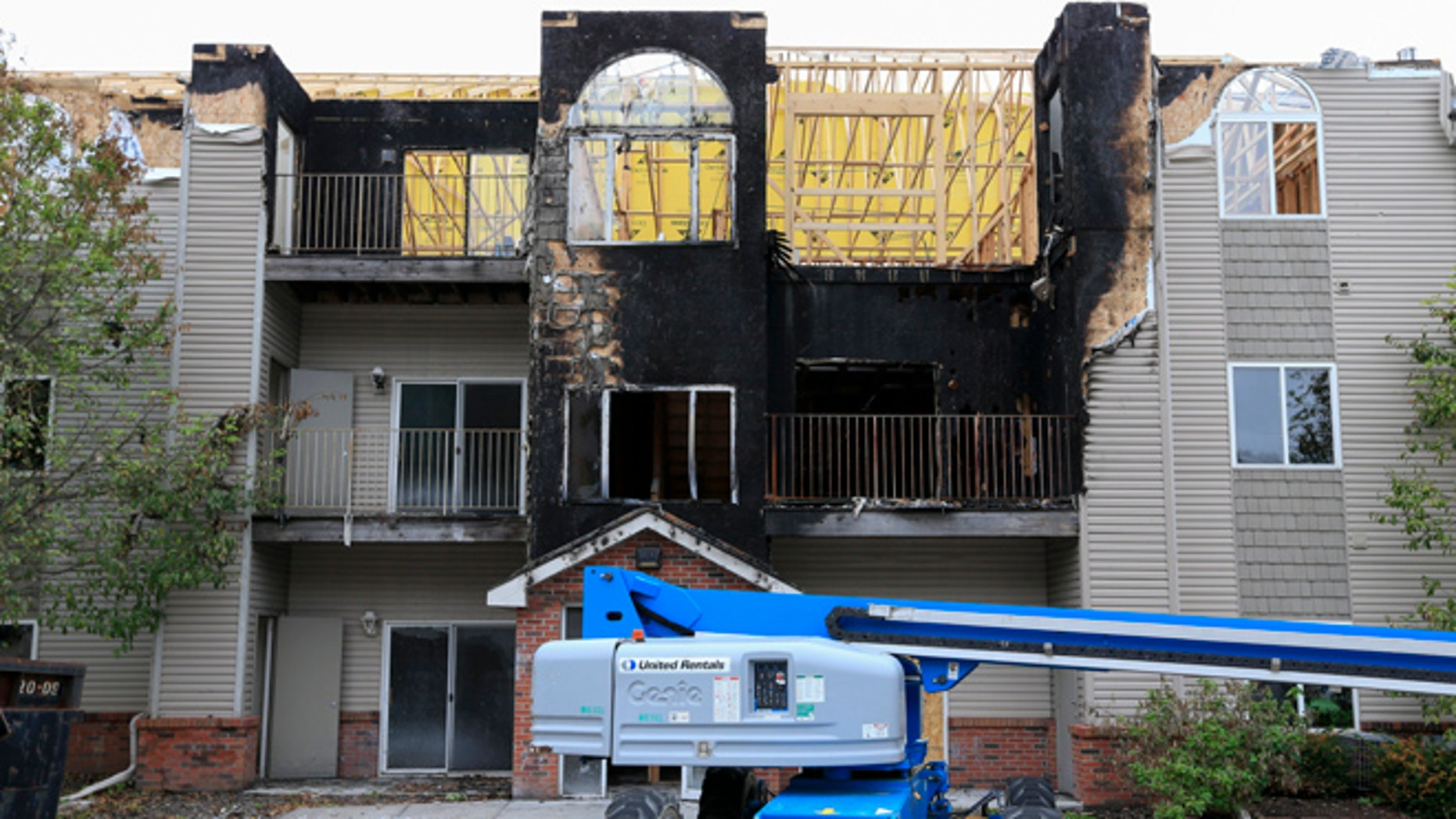In this Sept. 14, 2016, photo, restoration work is performed at a Bellevue, Neb., apartment complex which was hit twice by fire.