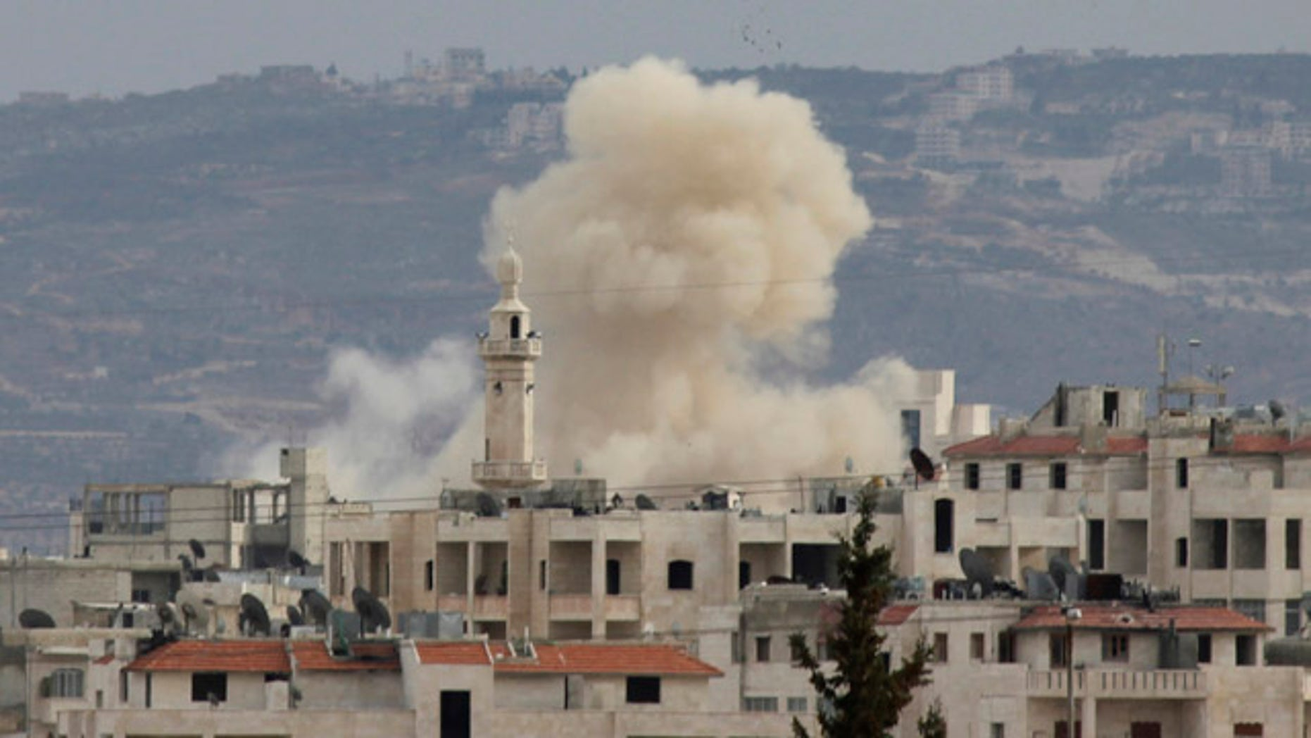 March 11: Smoke rises as Idlib city is shelled by government forces. Activists said at least four people were killed in Idlib on Sunday after troops and tanks moved in a day earlier.