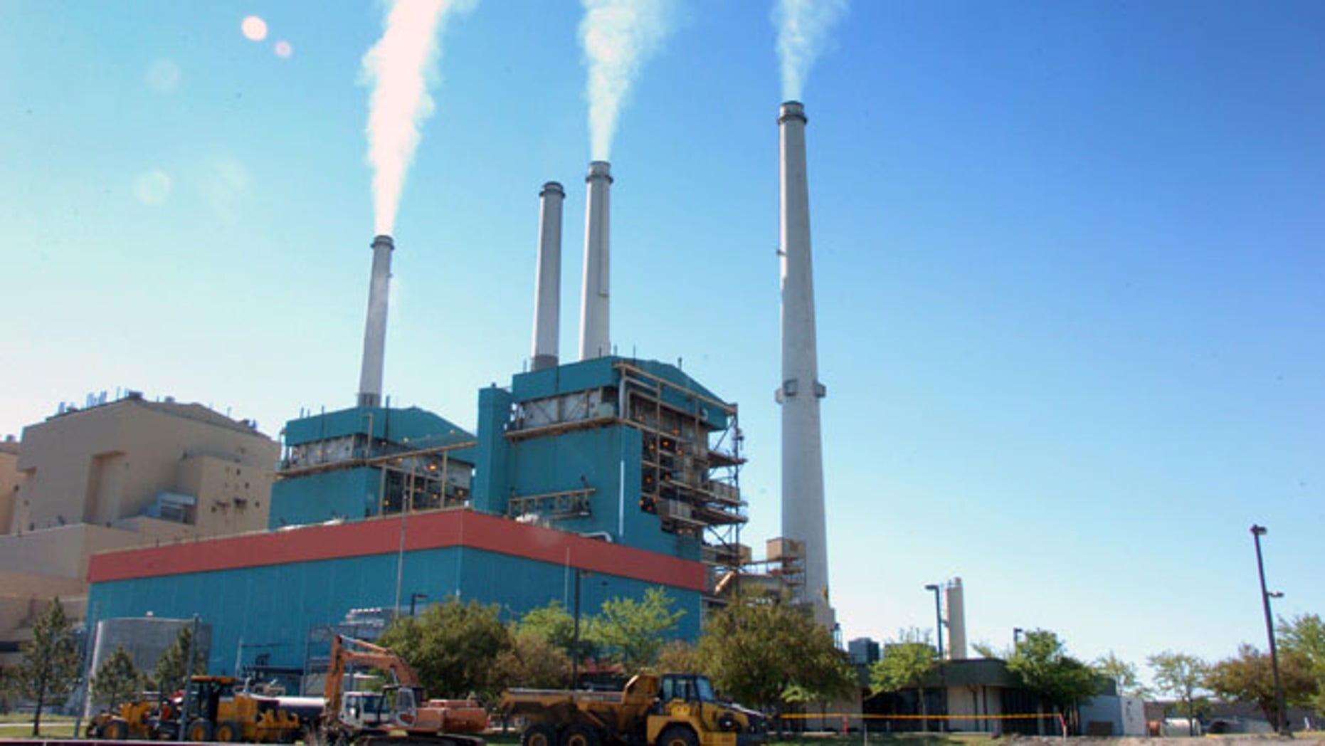 July 1, 2013 file photo shows smoke rises from the Colstrip Steam Electric Station, a coal burning power plant in Colstrip, Mont.
