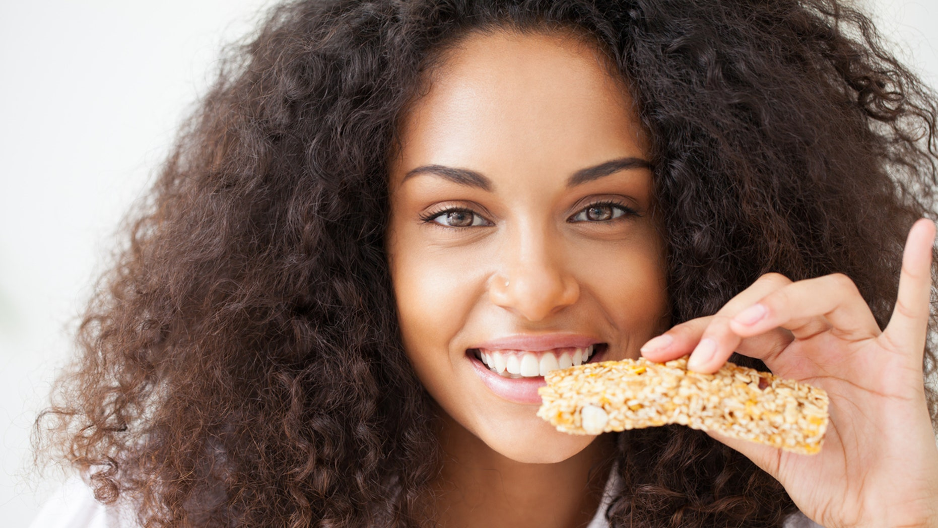 Young woman about to eat a healthy snack.