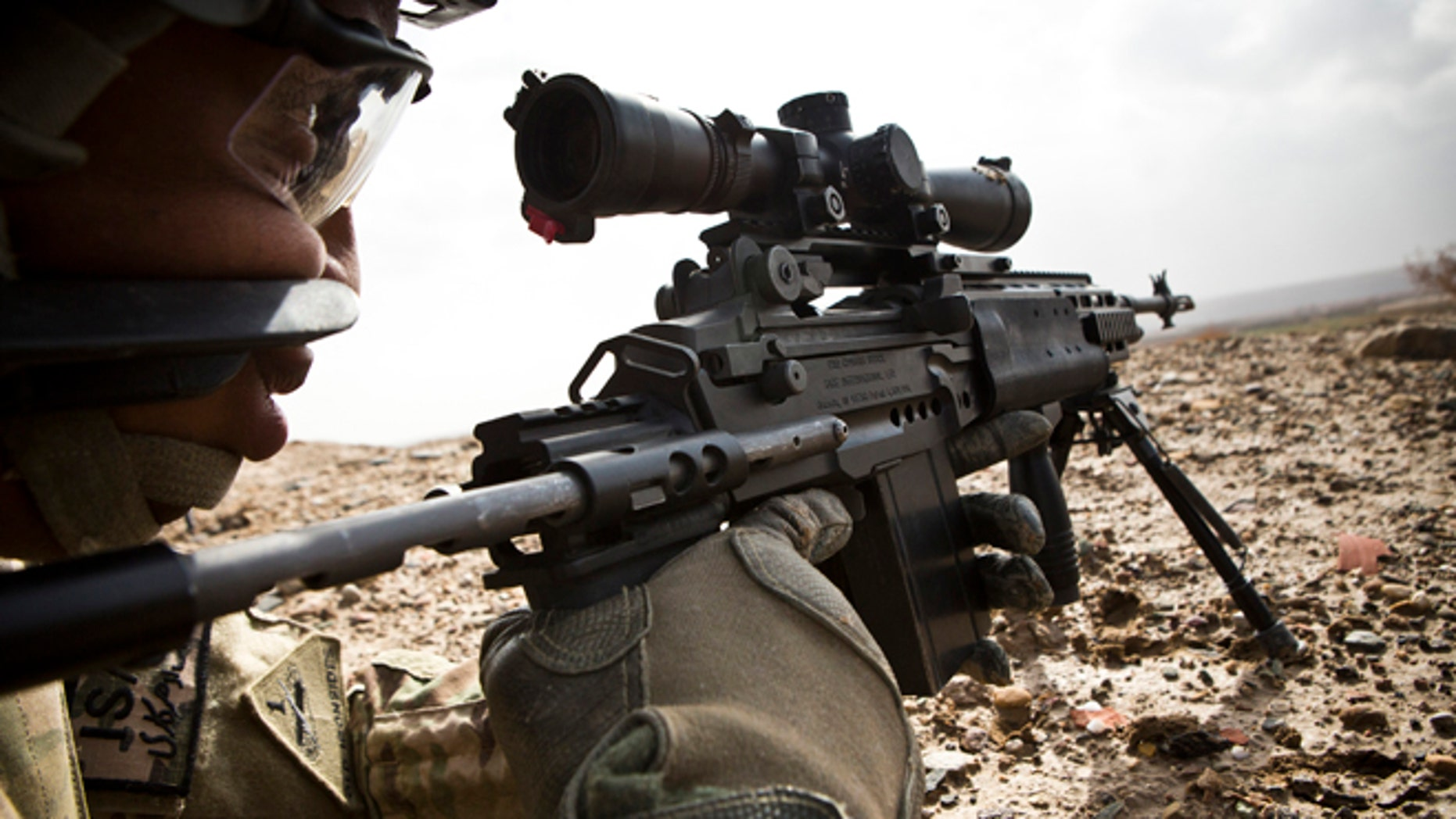 Feb. 3, 2013: A U.S. Army sniper with Charlie Company, 36th Infantry Regiment, 1st Armored Division looks down the scope of his rifle during a mission near Command Outpost Pa'in Kalay in Maiwand District, Kandahar Province.