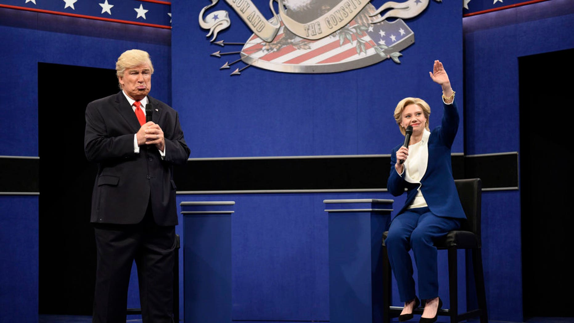"""SATURDAY NIGHT LIVE -- """"Emily Blunt"""" Episode 1707 -- Pictured: (l-r) Alec Baldwin as Republican Presidential Candidate Donald Trump and Kate McKinnon as Democratic Presidential Candidate Hillary Clinton during the """"Debate Cold Open"""" sketch on October 15, 2016 -- (Photo by: Will Heath/NBC)"""