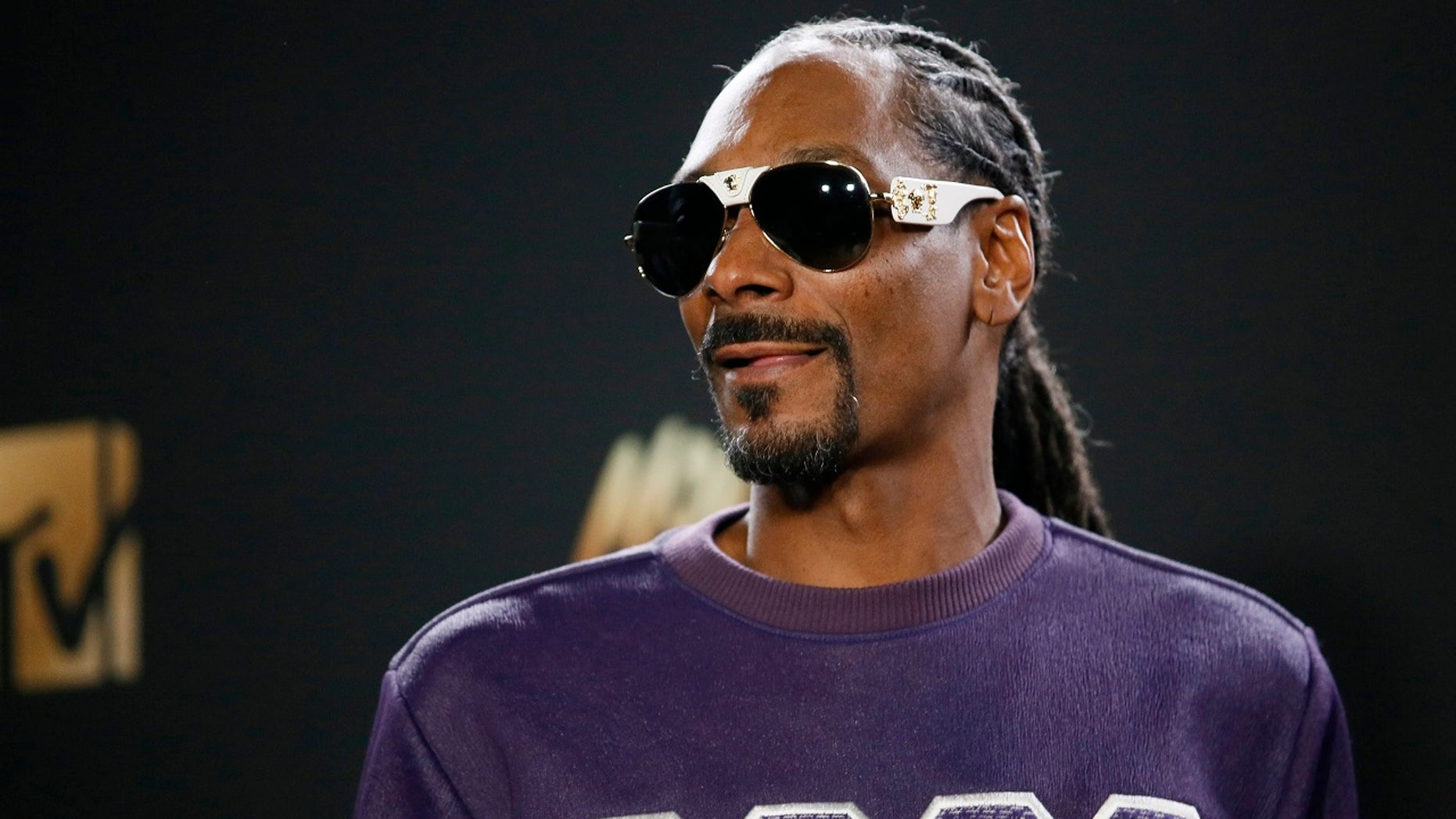 Rapper Snoop Dogg is seen in a video saying,