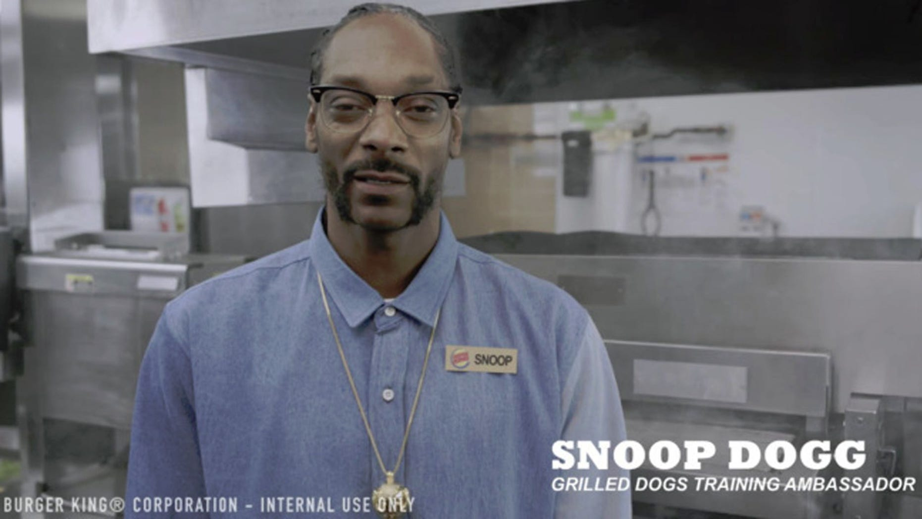 Snoop Dogg teaches Burger King staff how to grill up dogs his way.