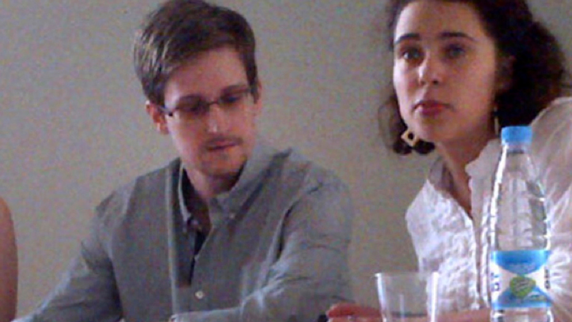NSA leaker Edward Snowden attends a news conference at Moscow's Sheremetyevo Airport with Sarah Harrison of WikiLeaks, left, Friday, July 12, 2013.