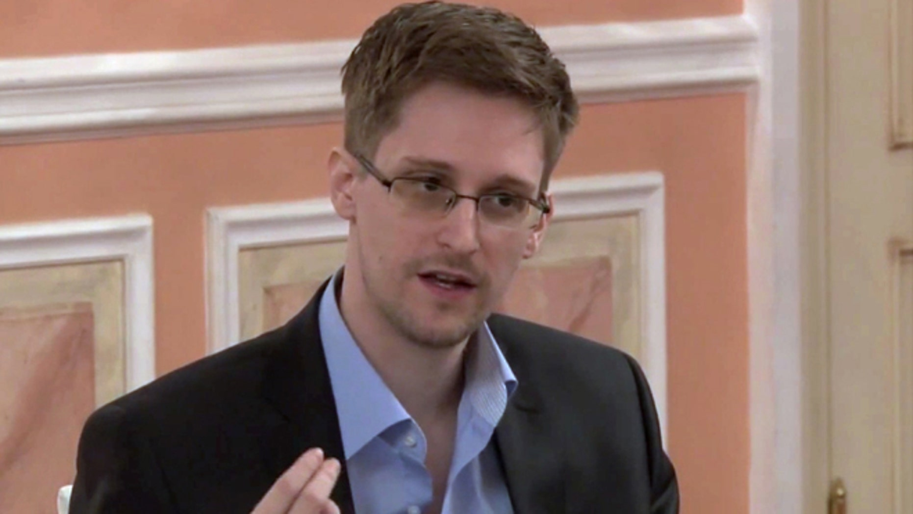 In this undated image made from video released by WikiLeaks, former National Security Agency systems analyst Edward Snowden speaks during a presentation ceremony for the Sam Adams Award in Moscow, Russia.