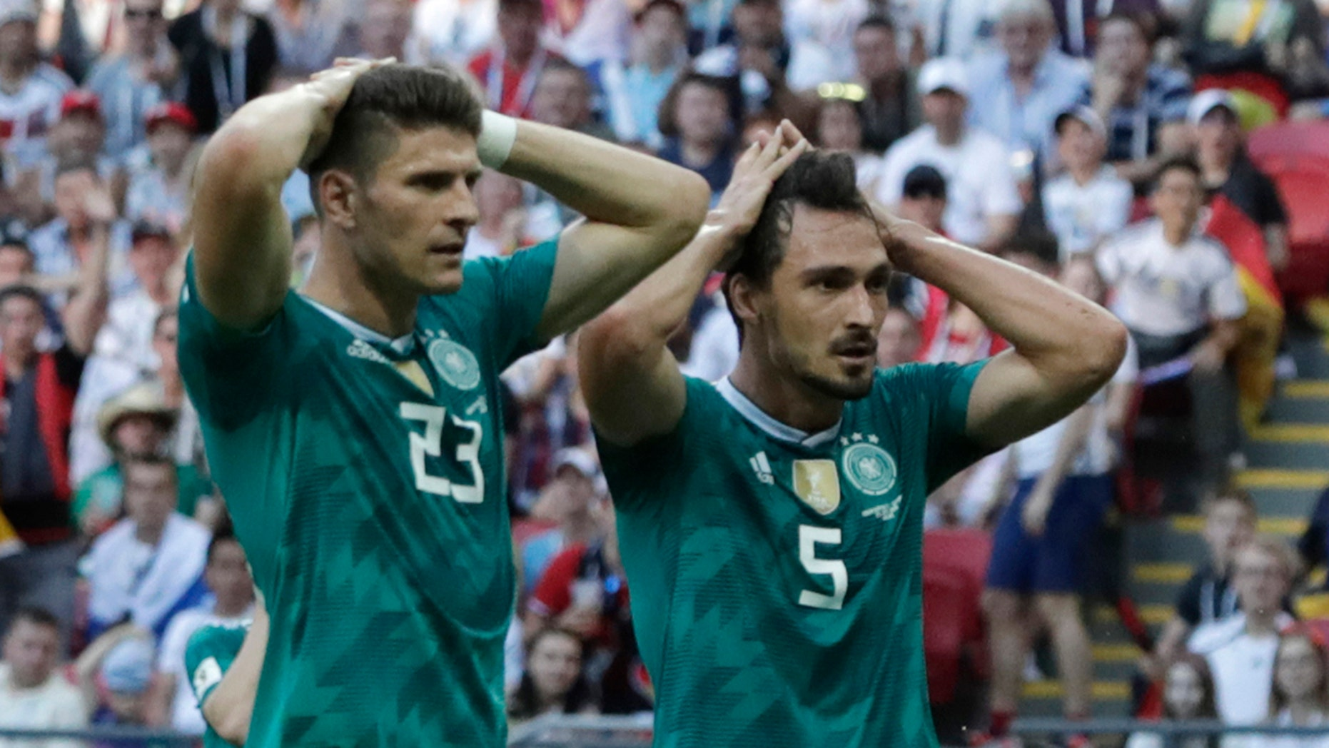 Germany's Mario Gomez, left, and Germany's Mats Hummels, right, hold their heads after failing to score during the group F match between South Korea and Germany.