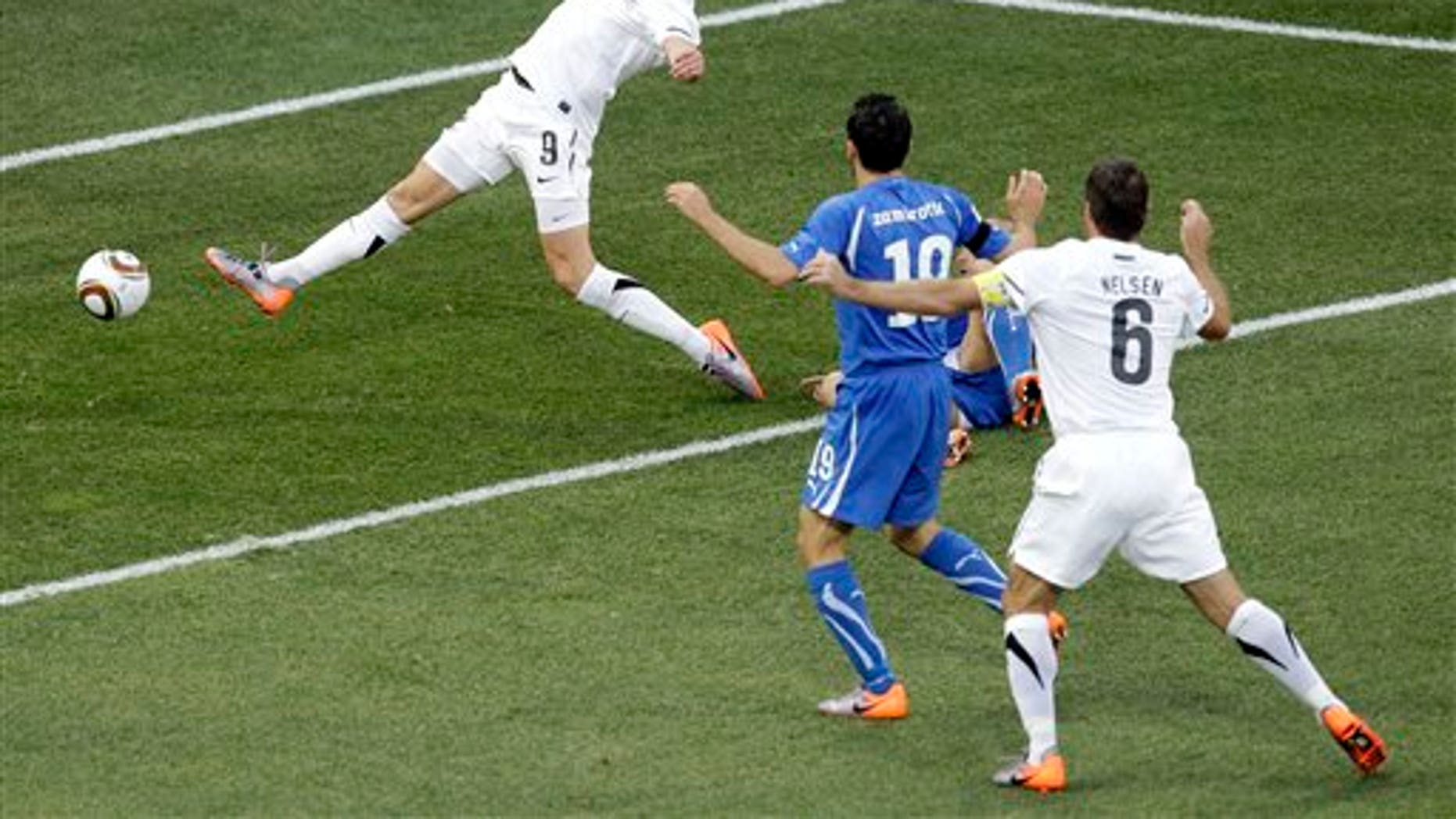 June 20: New Zealand's Shane Smeltz, top, scores during the World Cup group F soccer match between Italy and New Zealand at Mbombela Stadium in Nelspruit, South Africa. Security experts are using physics to keep hackers out of sensitive World Cup information.