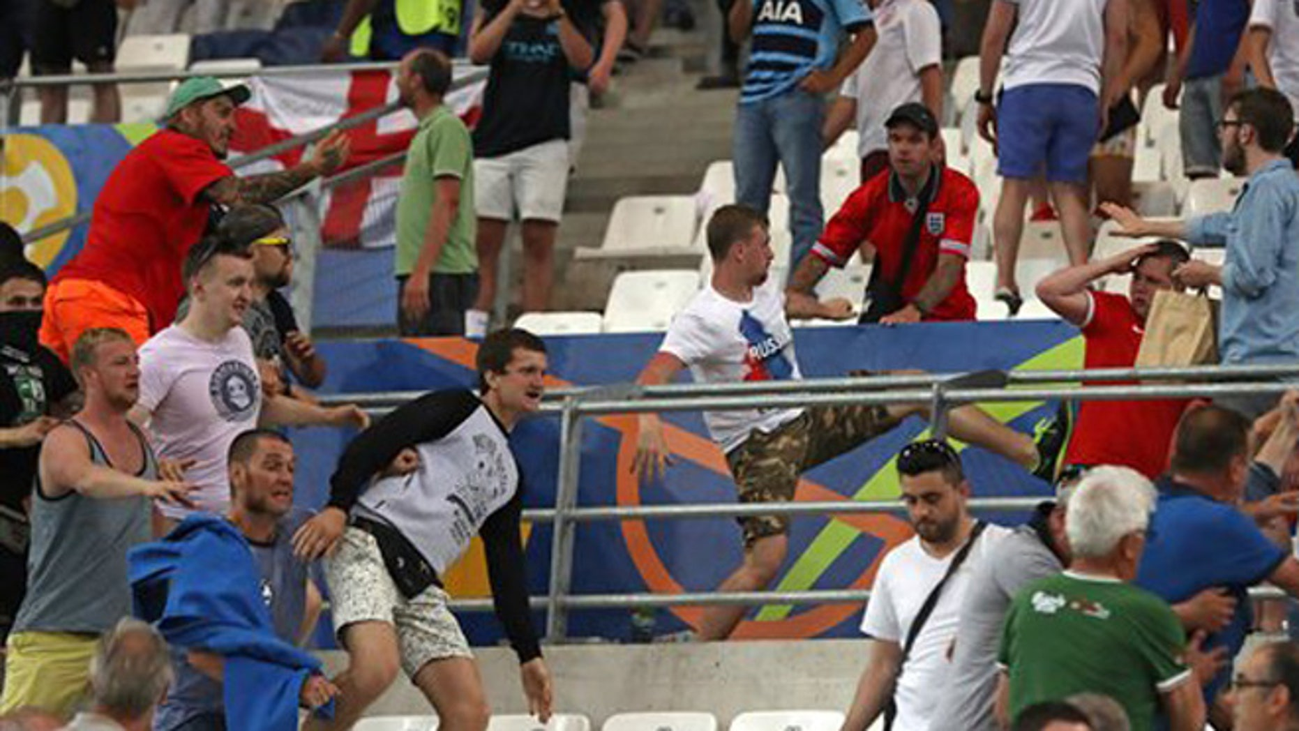 Russian supporters attack England fans at the end of the Euro 2016 Group B soccer match between England and Russia, at the Velodrome stadium in Marseille, France, Saturday, June 11, 2016.  (AP Photo/Thanassis Stavrakis)