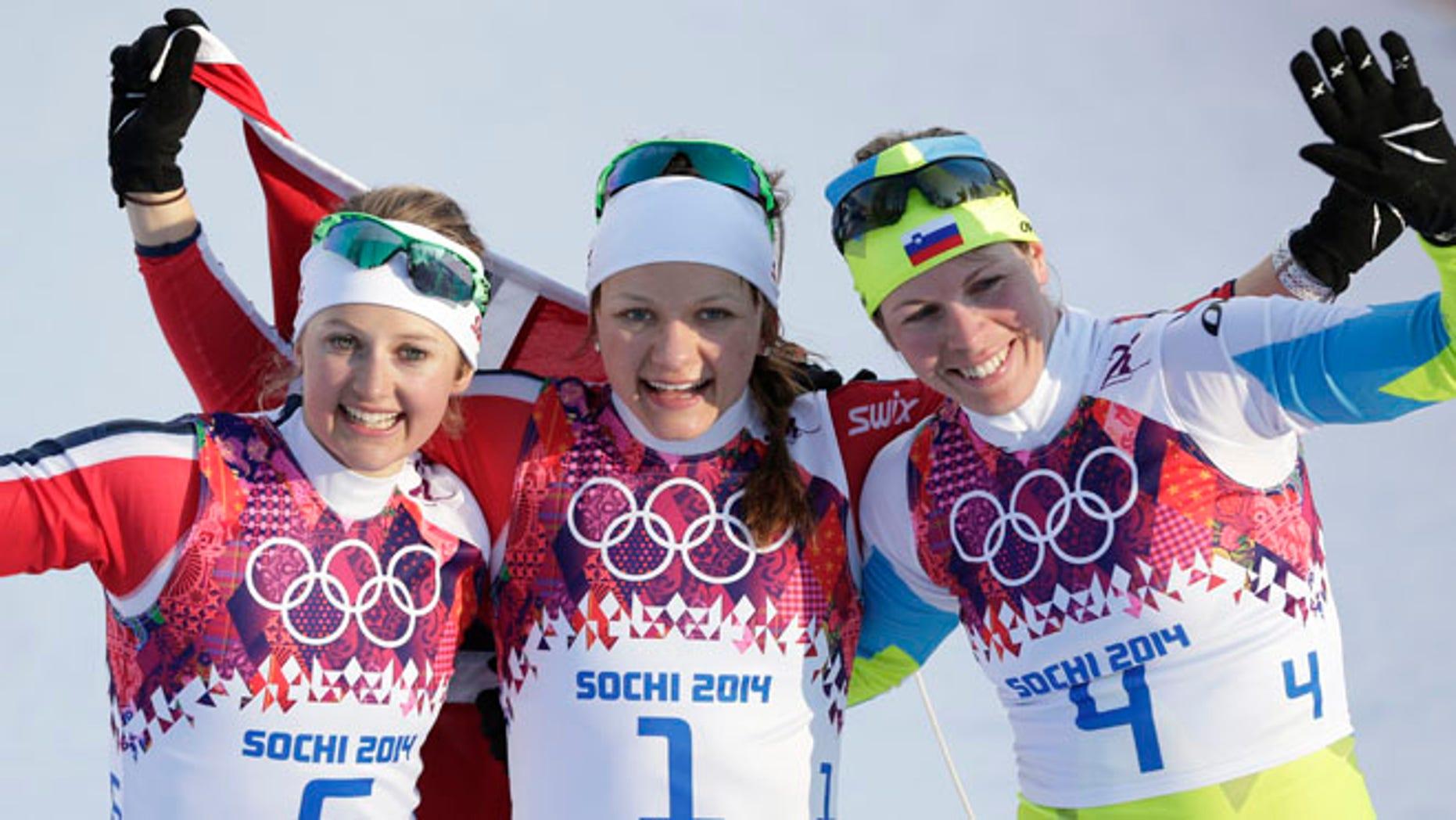 Feb. 11, 2014: Norway's gold medal winner Maiken Caspersen Falla is flanked by silver medal winner Ingvild Flugstad Oestberg from Norway, left, and Slovenia's bronze medal winner Vesna Fabjan after the women's cross-country sprint the 2014 Winter Olympics in Krasnaya Polyana, Russia.