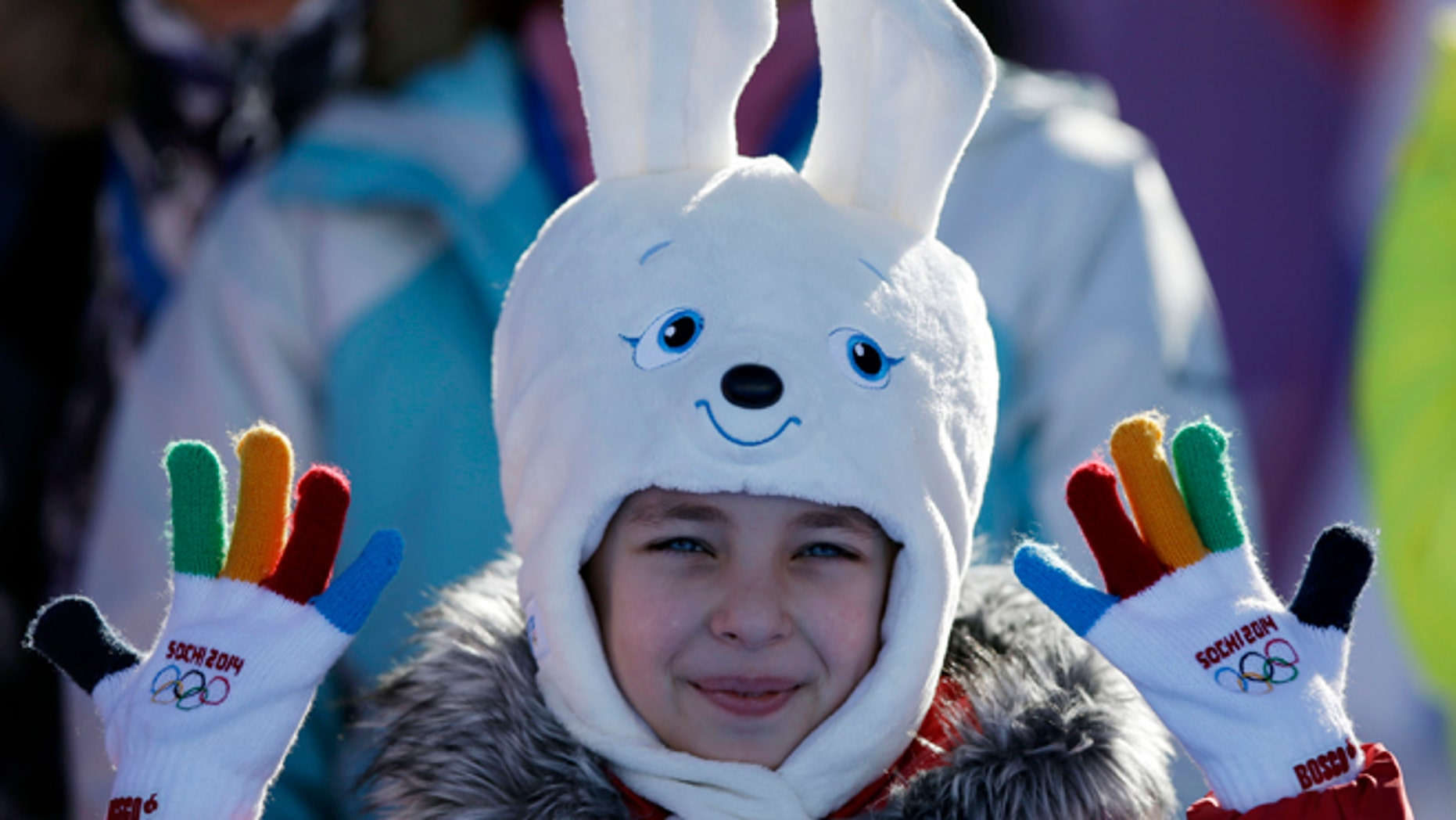 Feb. 6, 2014: A girl wears a hat in the shape of the Sochi Winter Olympics mascot while watching the men's snowboard slopestyle qualifying at the Rosa Khutor Extreme Park ahead of the 2014 Winter Olympics in Krasnaya Polyana, Russia.