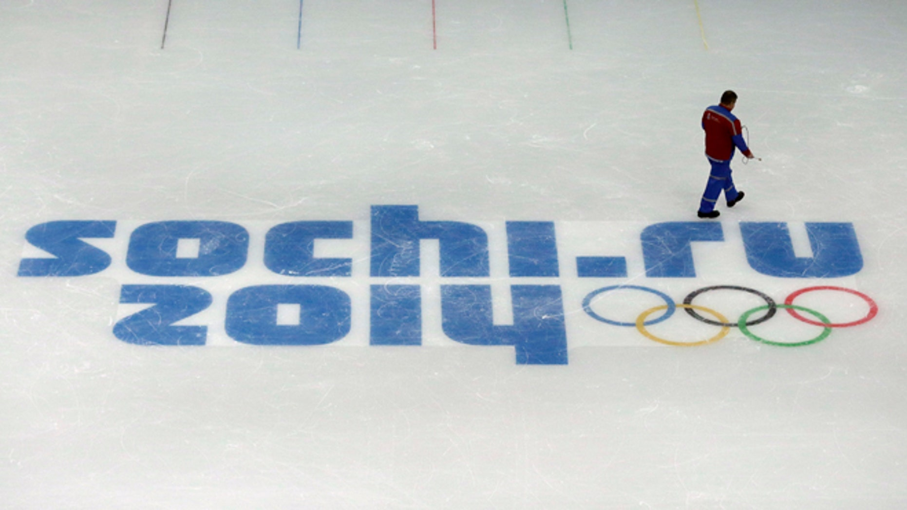 Jan. 25, 2014: A worker leaves after checking ice conditions at the Iceberg Skating Palace, where the figure skating and short track speed skiing will take place, at the 2014 Winter Olympics in Sochi, Russia. The Olympics begin Feb. 7th.