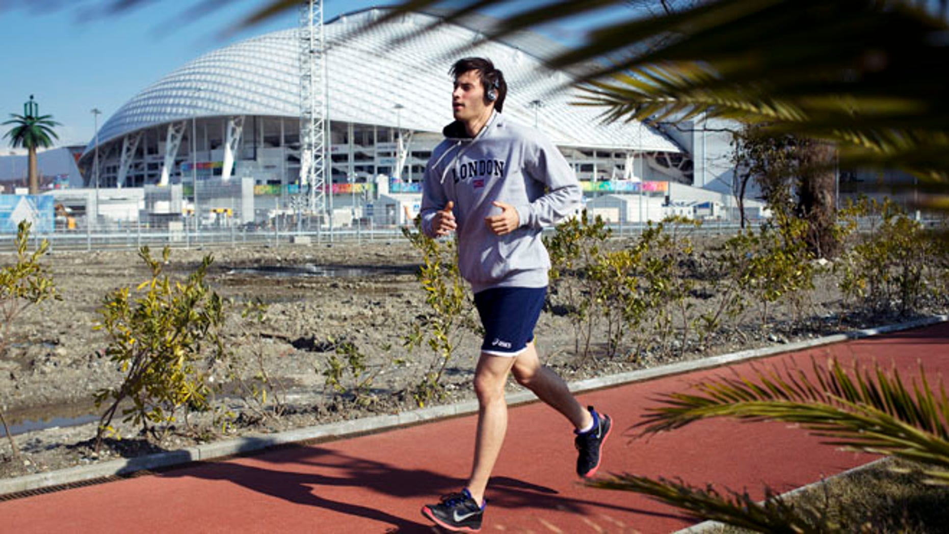 Feb. 10, 2014: A man runs at a boardwalk near the Fisht Olympic Stadium in Olympic Park during the 2014 Winter Olympics in Sochi, Russia.