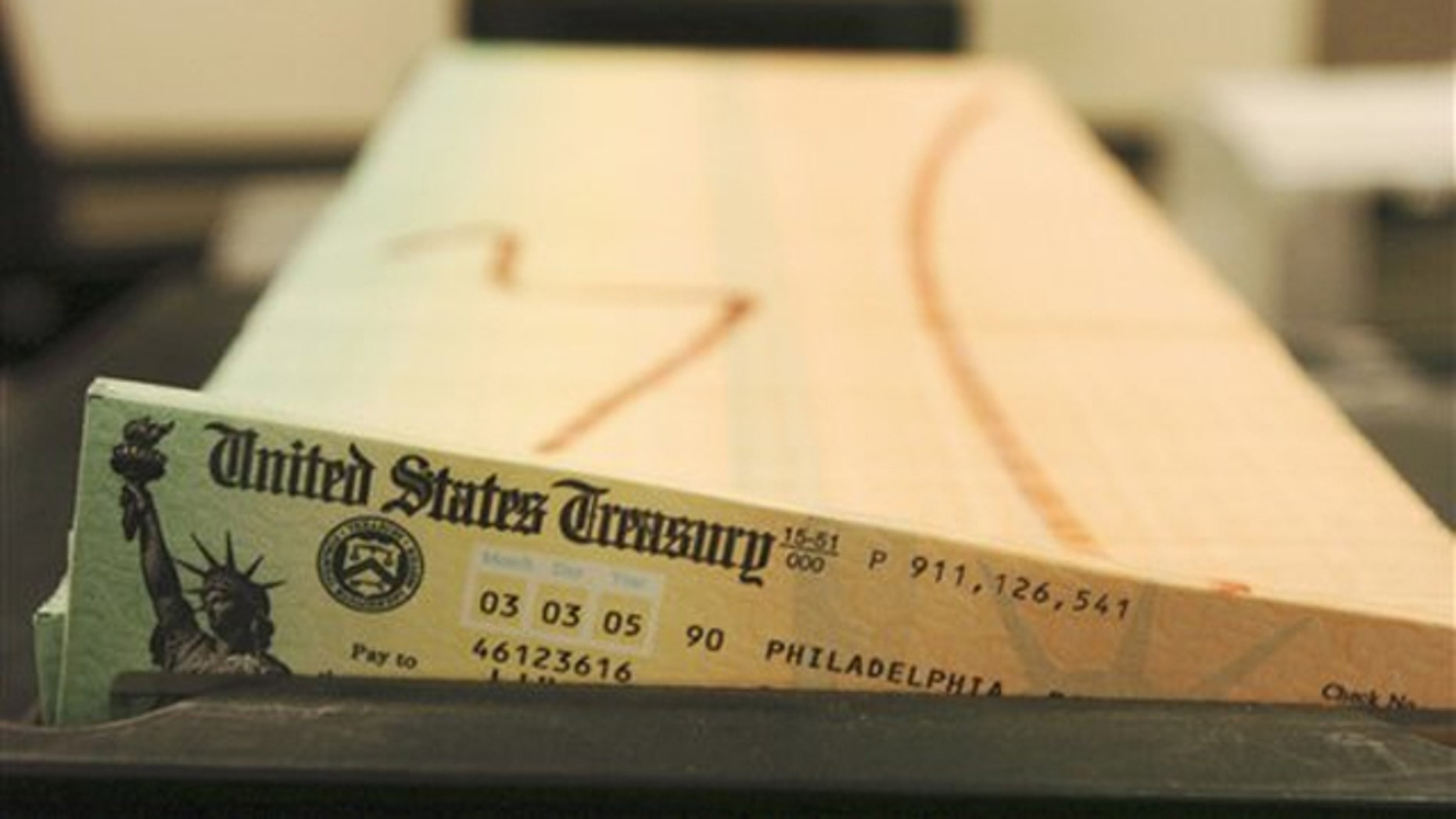 In this Feb. 11, 2005, file photo, trays of printed social security checks wait to be mailed from a facility in Philadelphia.