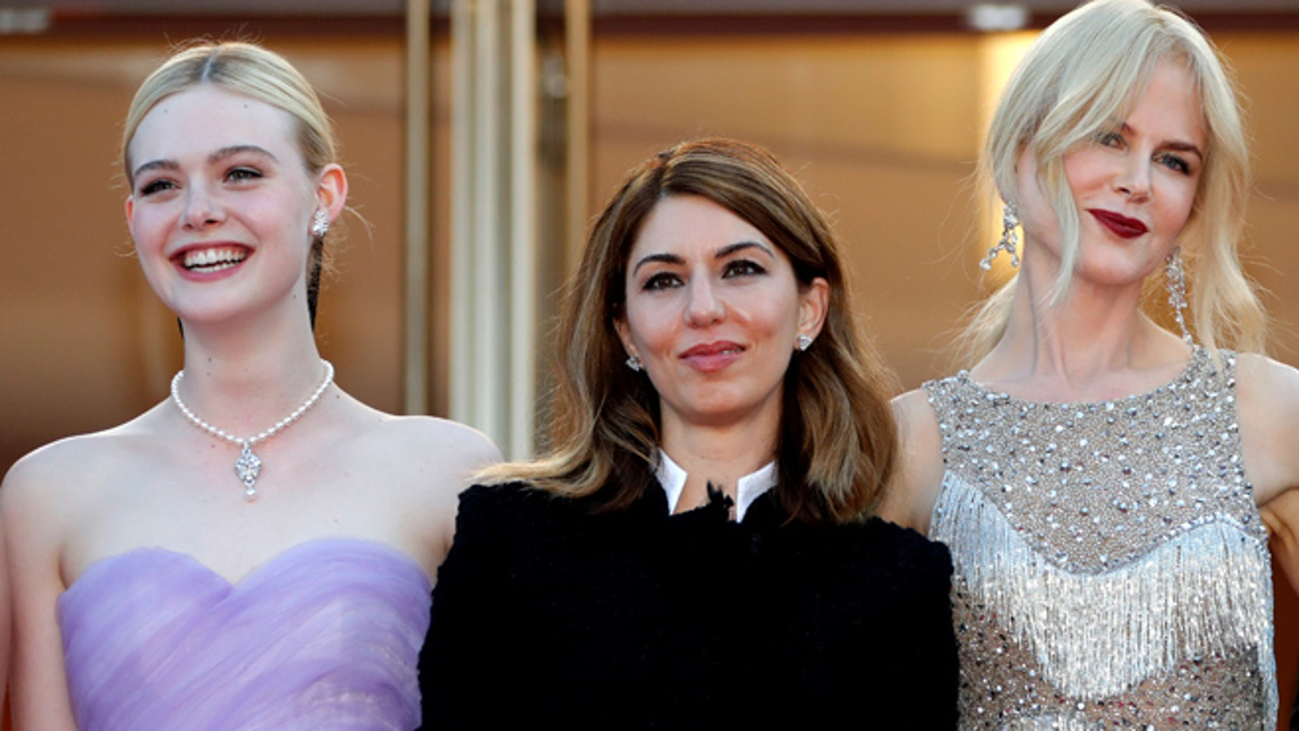 Sofia Coppola (center) with Elle Fanning and Nicole Kidman became only the second woman to win best director at the Cannes Film Festival.