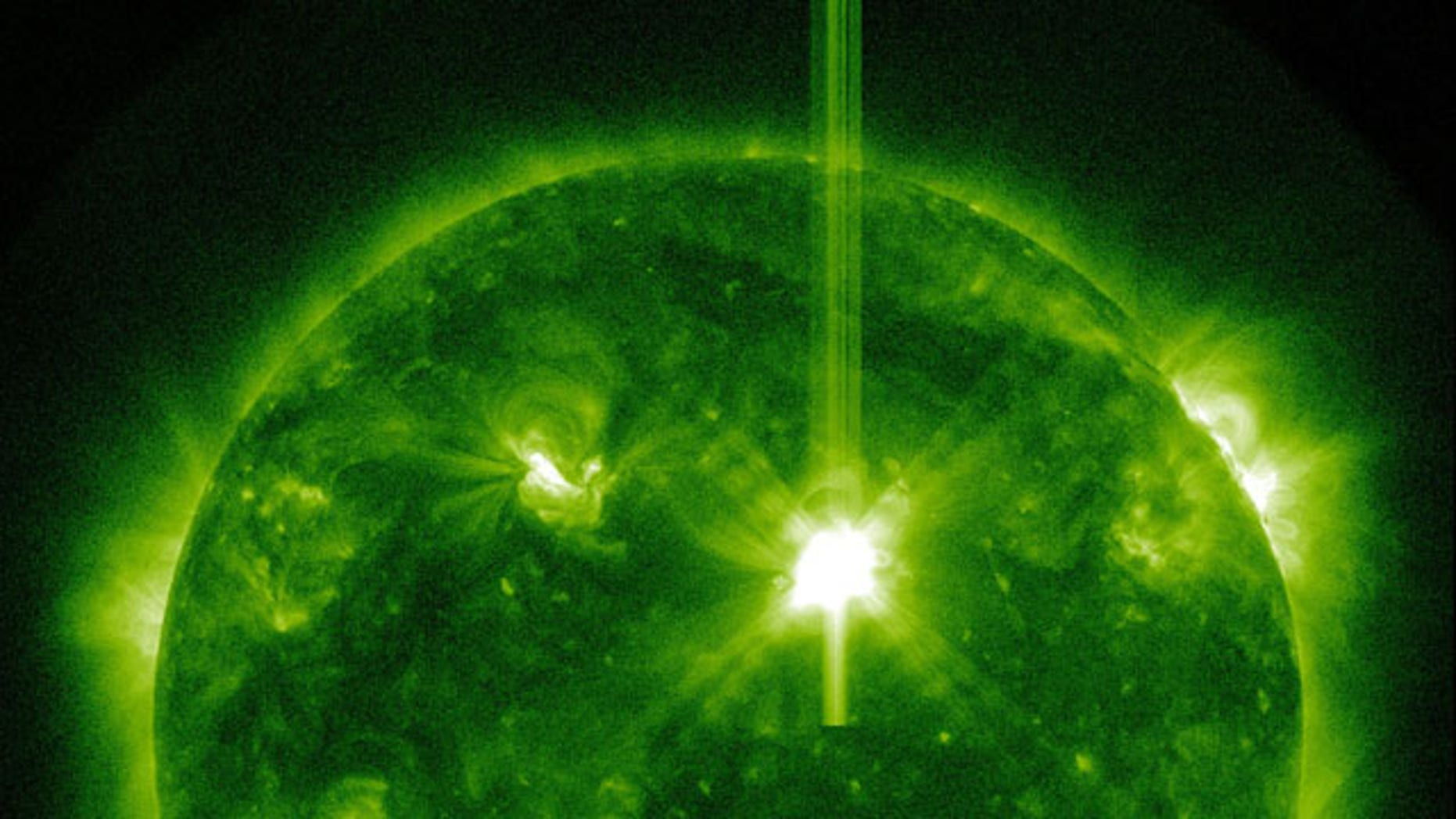 The sun unleashed a powerful Class X1.5 solar flare on March 9, 2011, a solar storm that could supercharge Earth's auroras. The flare was recorded by NASA's Solar Dynamics Observatory and other spacecraft. Here, it appears in white at the upper right of the sun as seen by the Solar Dynamics Observatory.