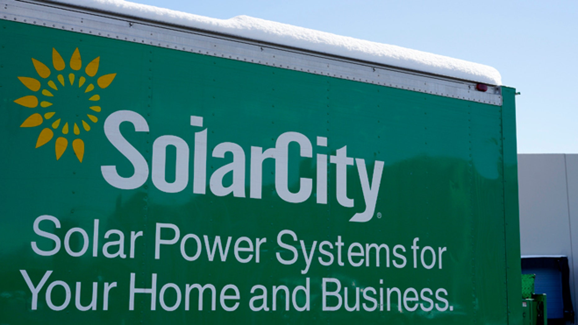 A sign is seen at the SolarCity building in Denver Feb. 17, 2015. (Reuters)