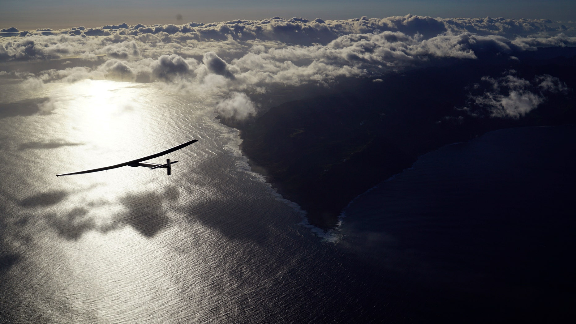 In this photo provided by Solar Impulse, the solar-powered plane, Solar Impulse 2, piloted by Bertrand Piccard, is seen in the air Thursday, April 21, 2016, after successfully taking off from Kalaeloa Airport, Hawaii, for a non-stop three day flight expected to cover about 2,336 miles to Moffett Airfield, Calif. (Jean Revillard/Solar Impulse via AP)