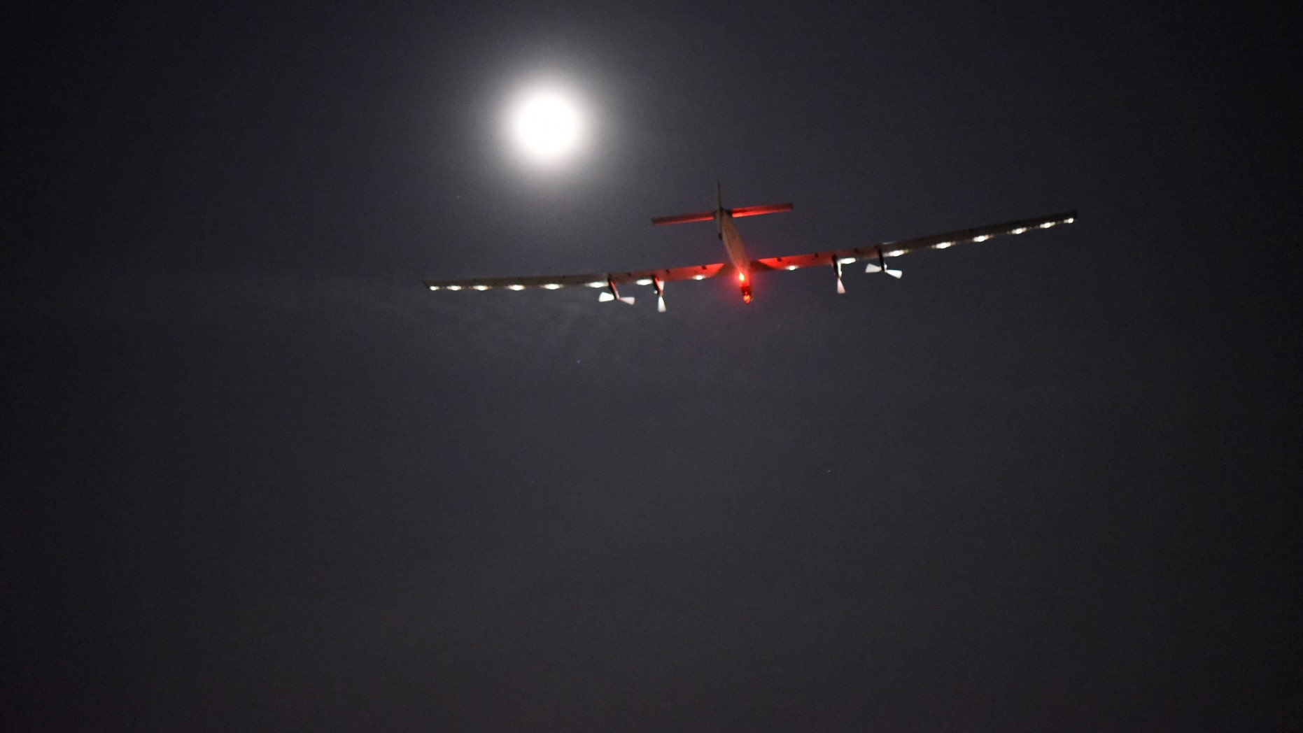 """File photo - In this photo provided by Solar Impulse, """"Solar Impulse 2,"""" the solar airplane of Swiss pioneers Bertrand Piccard and Andre Borschberg, moves through the sky shortly after the take off from Dayton International Airport, in Dayton, Ohio to Lehigh Valley International Airport in Allentown, Pa., on Wednesday, May 25, 2016. (Jean Revillard/Solar Impulse via AP"""
