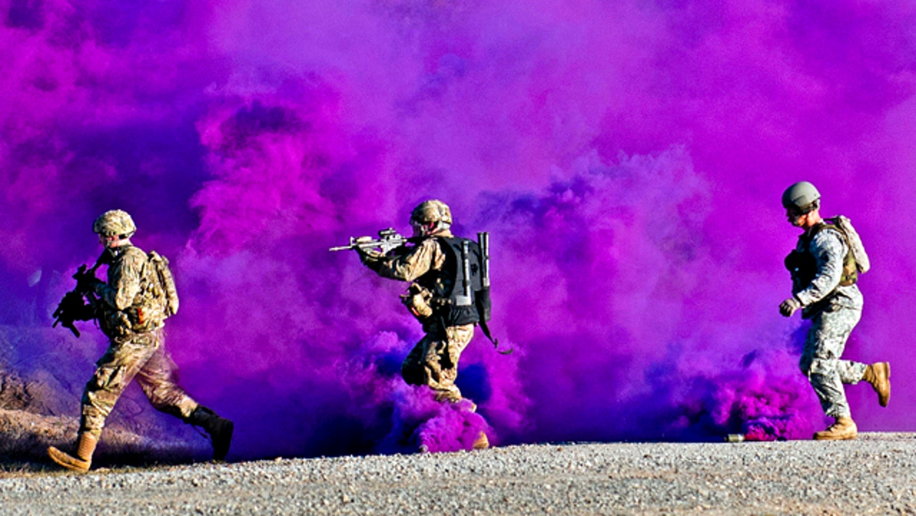 Jan. 14, 2012: Paratroopers run through a smokescreen during a live-fire exercise at the Joint Readiness Training Center, Fort Polk, La. Hight-tech undergarments will let the Army monitor warfighters of the future -- alerting a command center to the exact status of men on the ground.